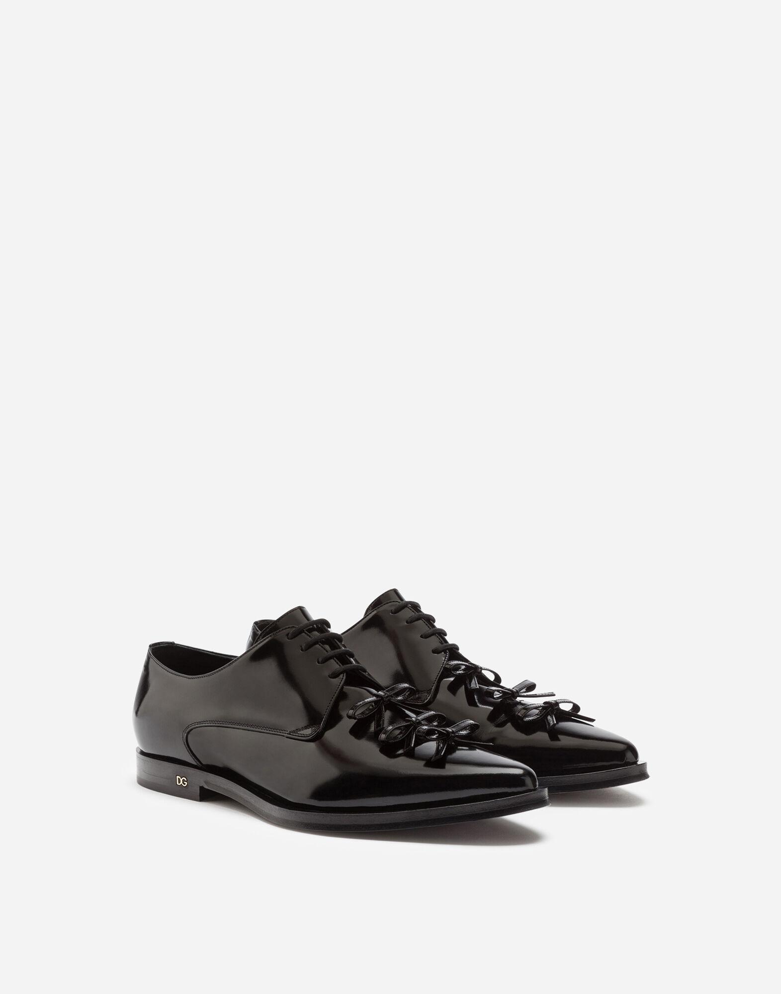 Polished calfskin derby with bows 1