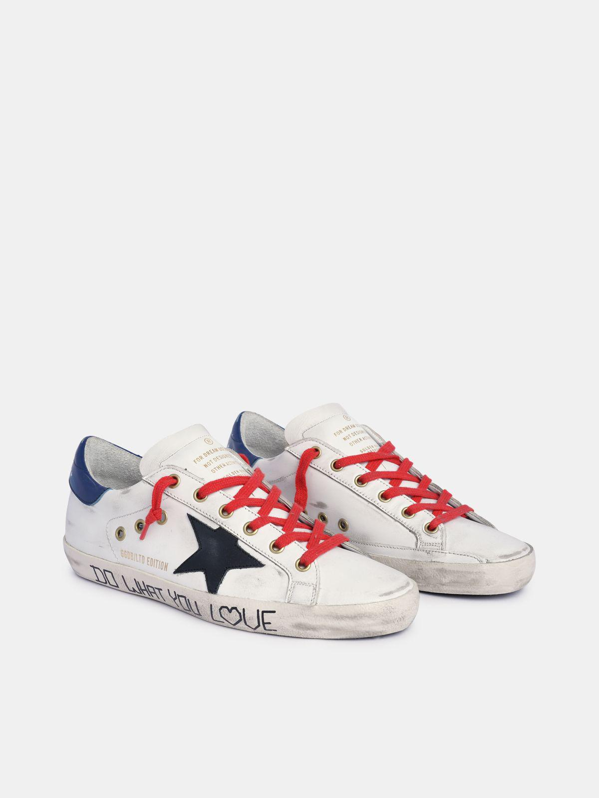 Super-Star sneakers in white leather with black star and blue heel tab 2