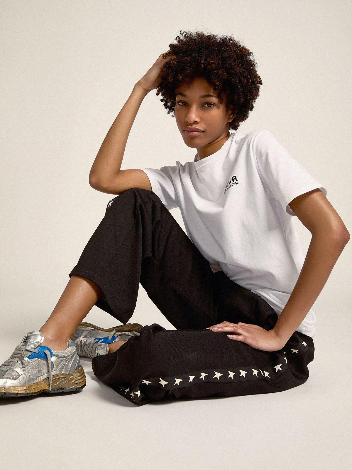 Black Dorotea Star Collection jogging pants with white stars on the sides 1
