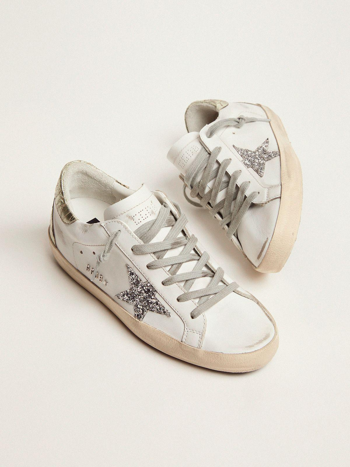 Super-Star sneakers with silver glitter star and glossy gold leather heel tab 1