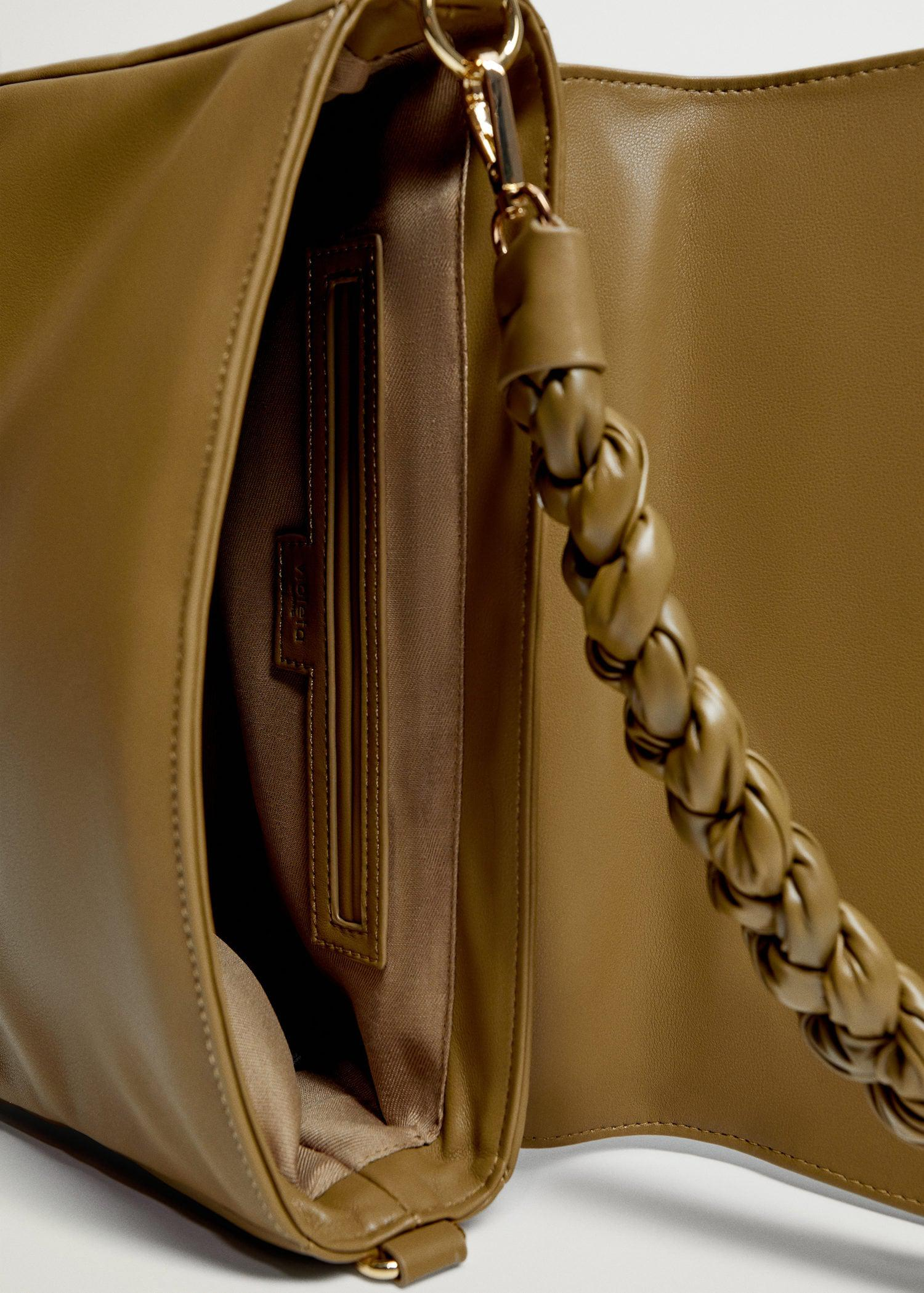 Crossbody bag with twisted strap 2
