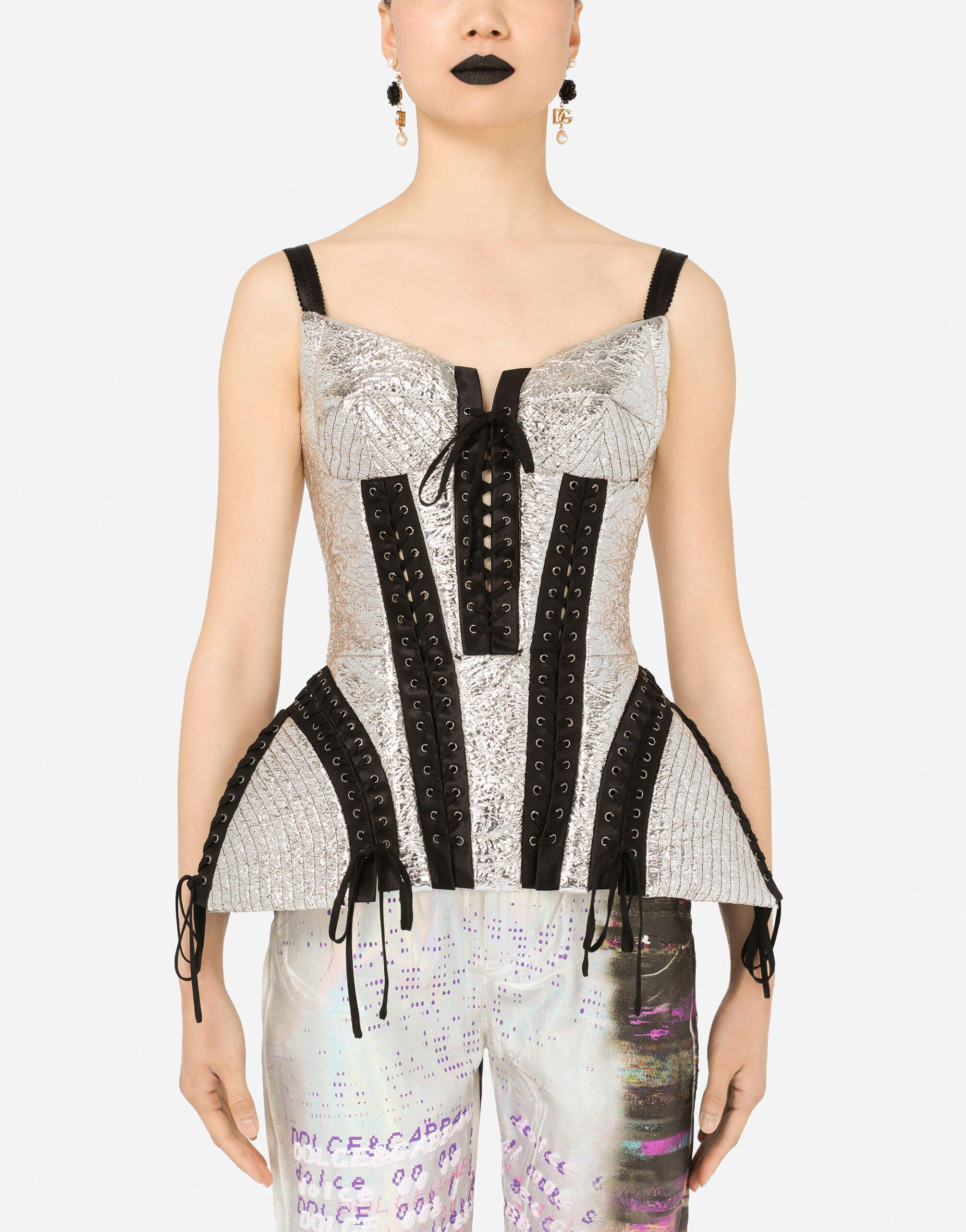 Laminated bustier with laces and eyelets