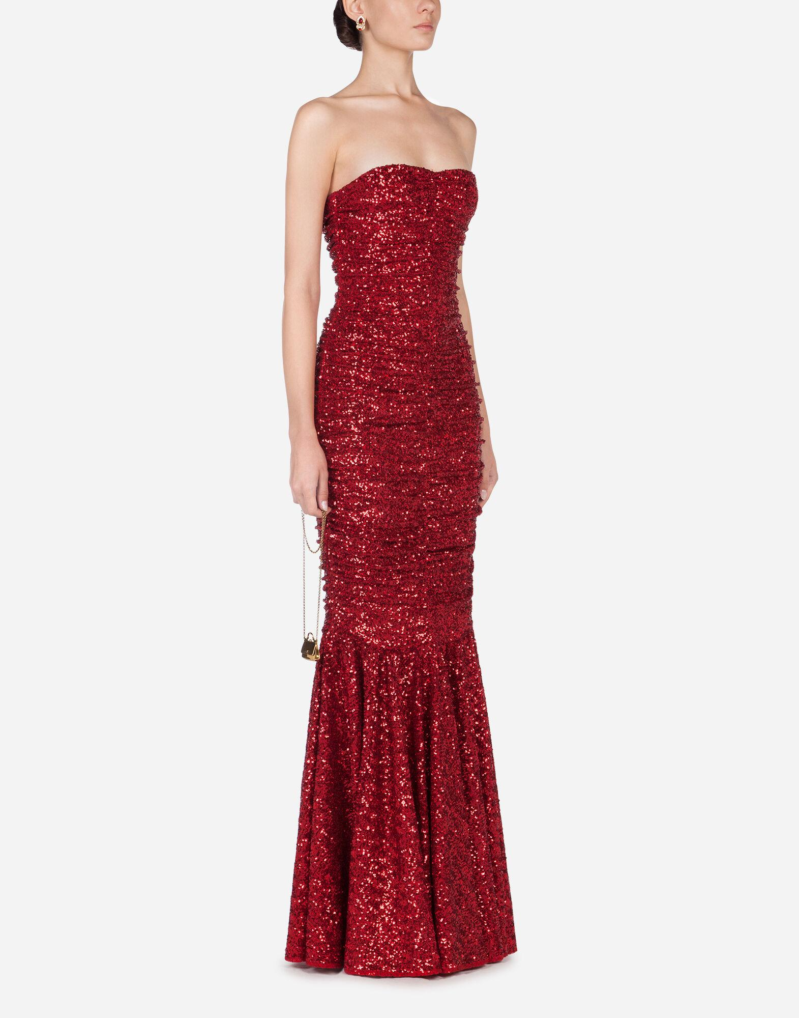 Long dress draped in sequins