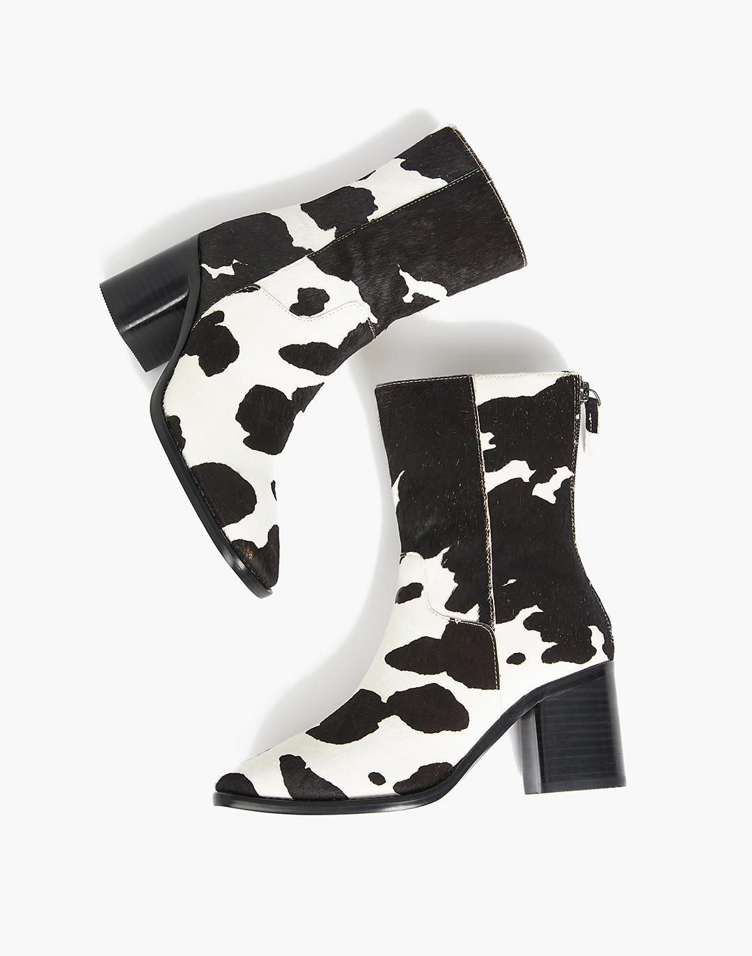 INTENTIONALLY BLANK PG Moo Boots