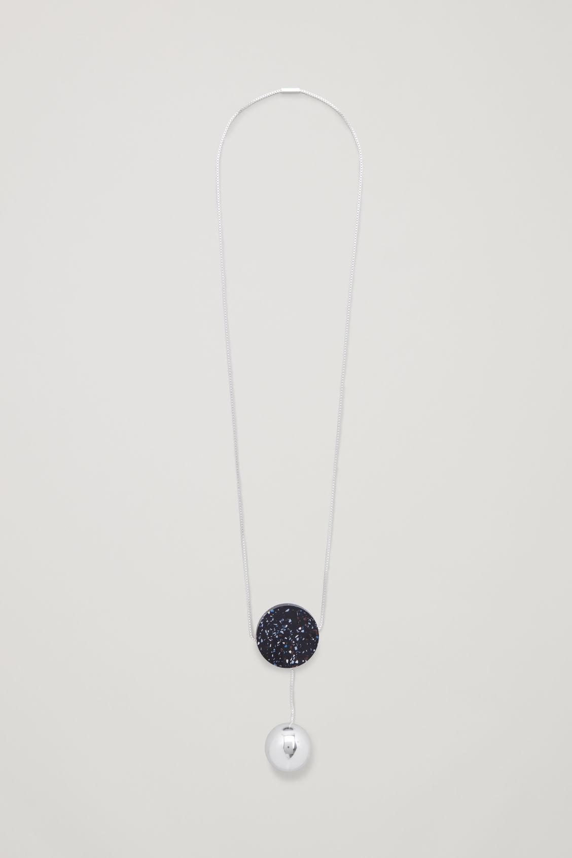 LONG SILVER AND STONE PENDANT