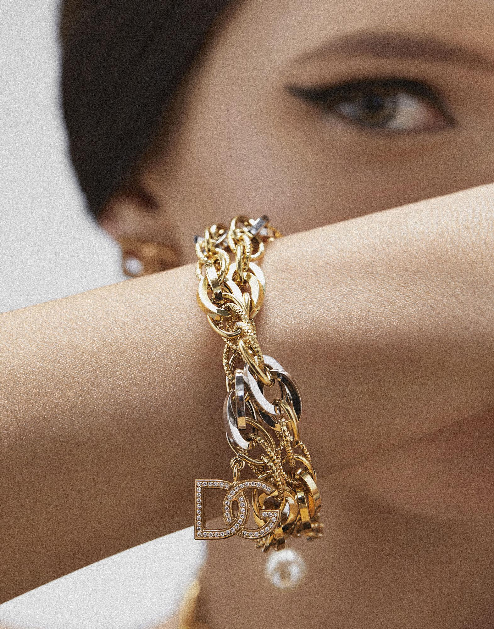 Logo bracelet in yellow and white 18kt gold with colorless sapphires 5