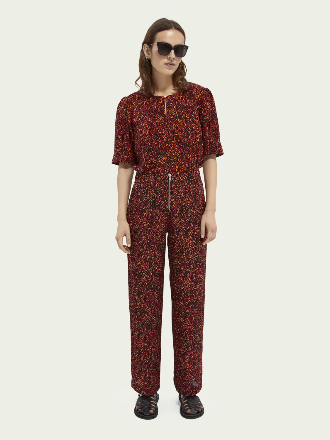 Printed mid-rise trousers 4