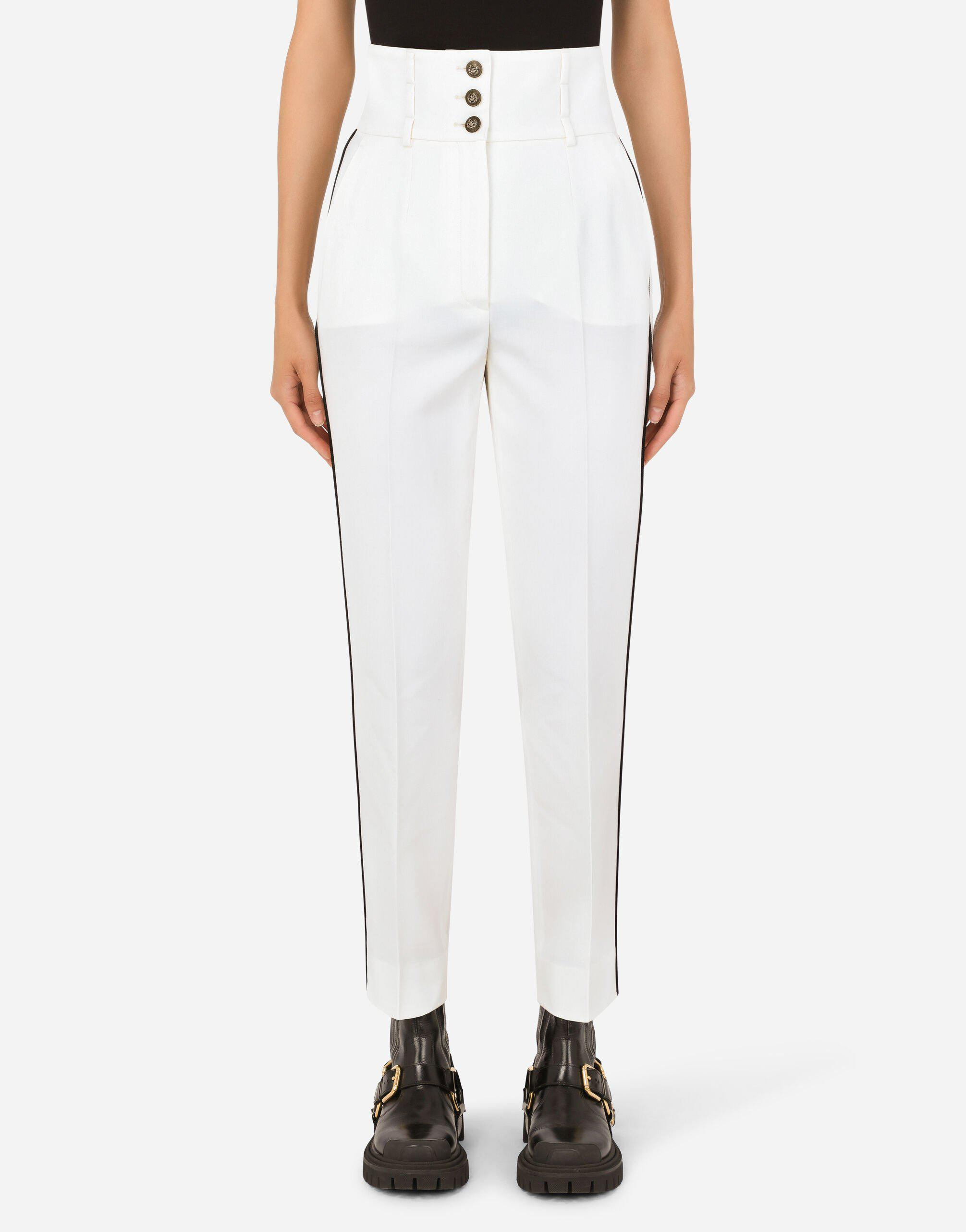 High-waisted twill pants with heraldic buttons