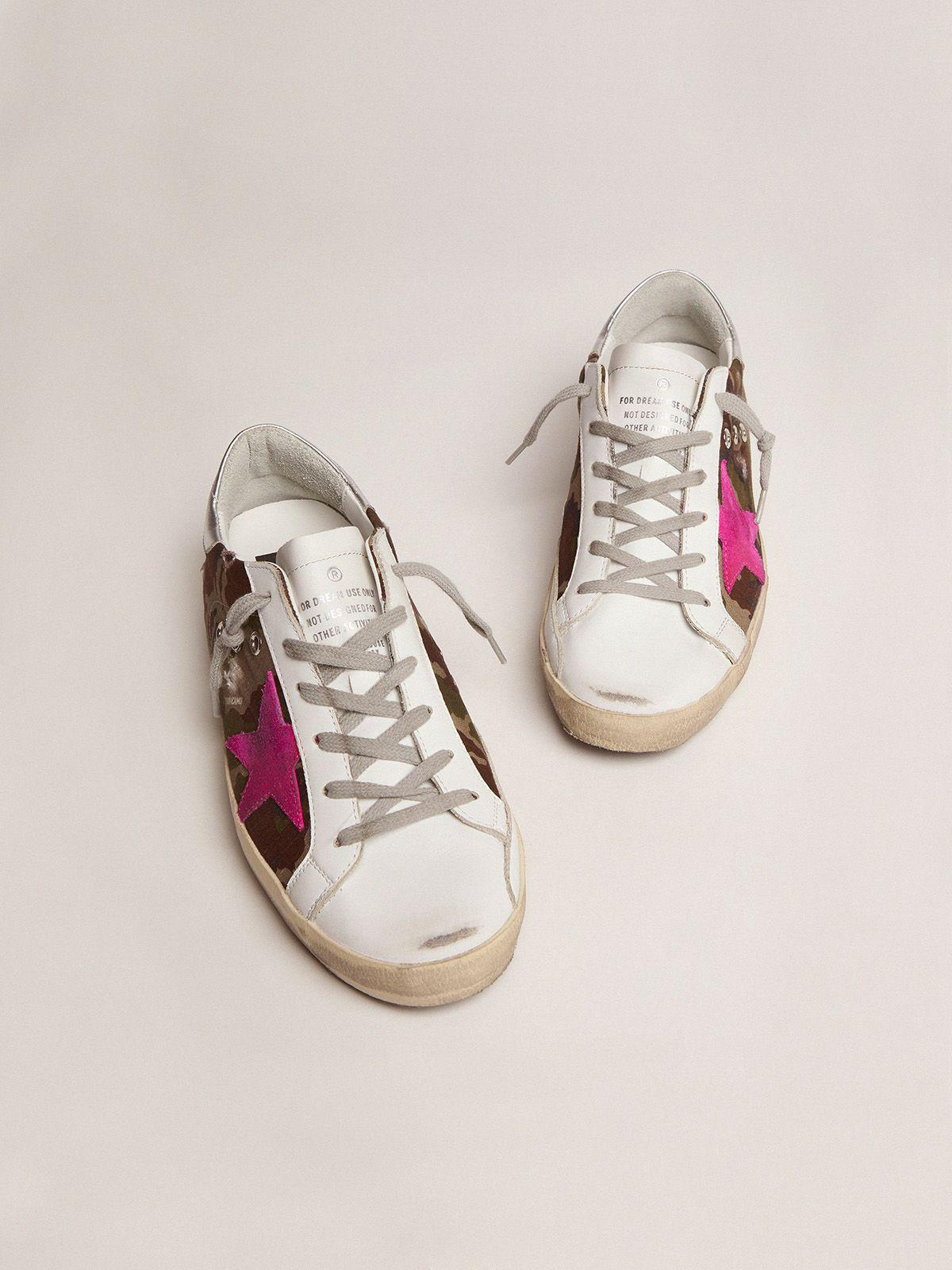 Super-Star sneakers with camouflage pattern and fuchsia star 1