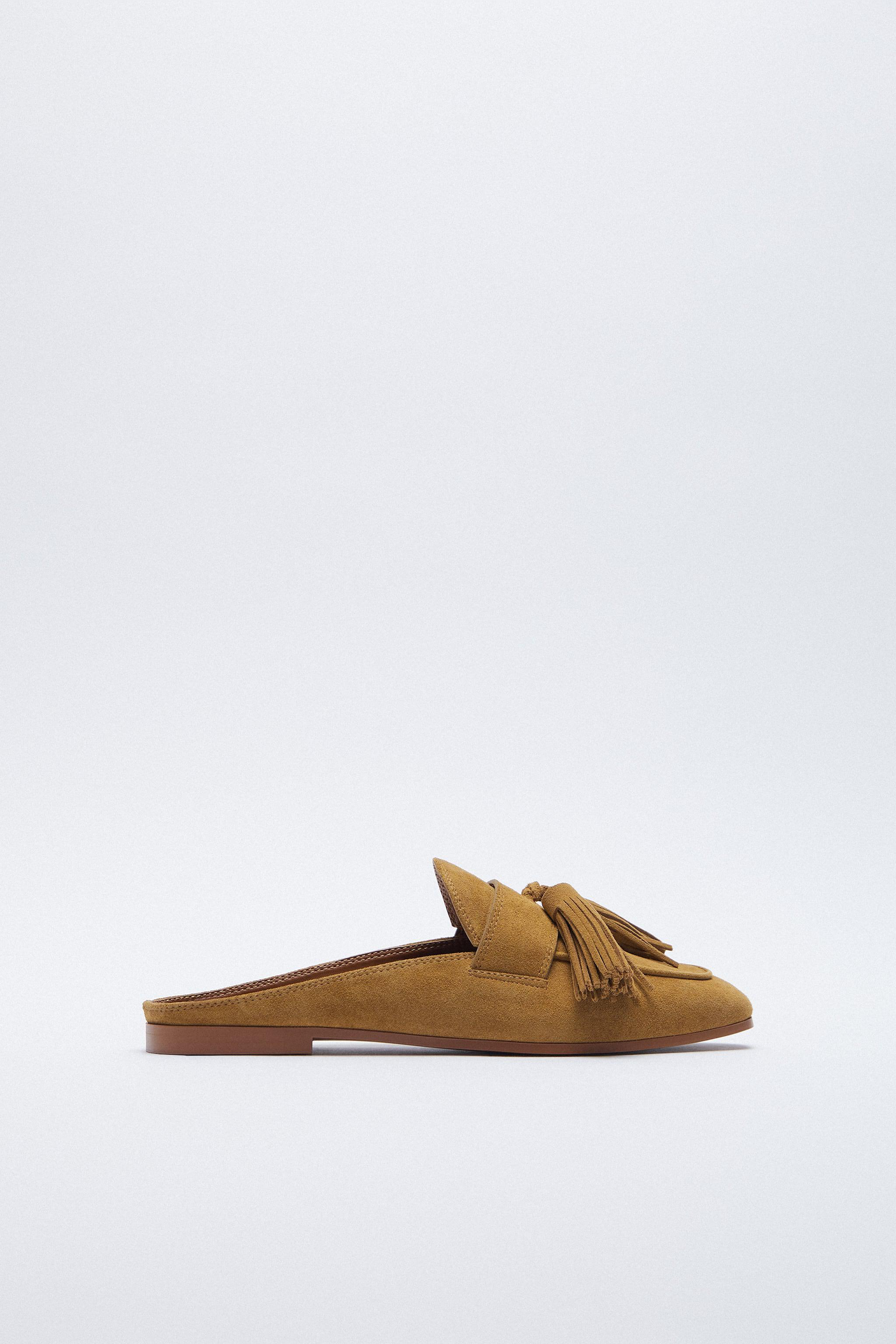 LEATHER MULES WITH TASSELS