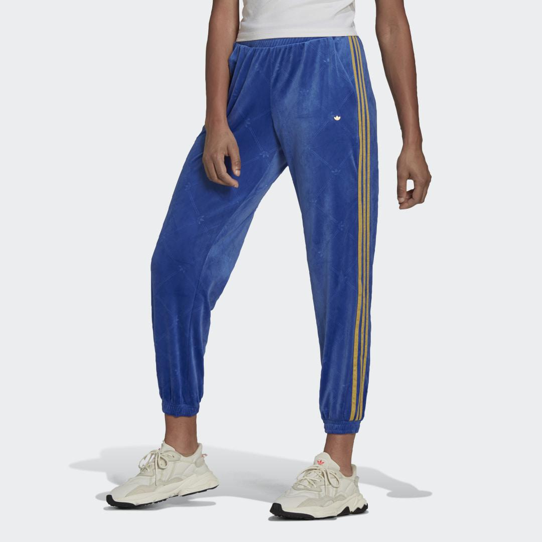 Track Pants in Velvet with Embossed adidas Originals Monogram and Gold Stripes Blue
