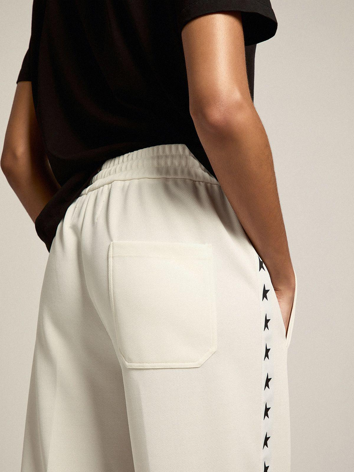 Papyrus white Dorotea Star Collection jogging pants with black stars on the sides 3