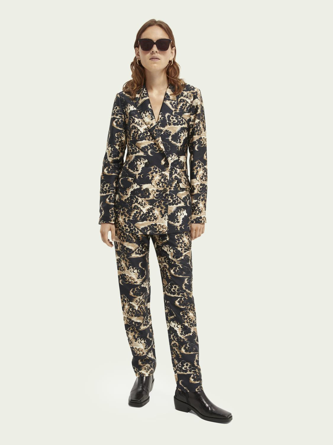 Printed tapered mid-rise trousers 4