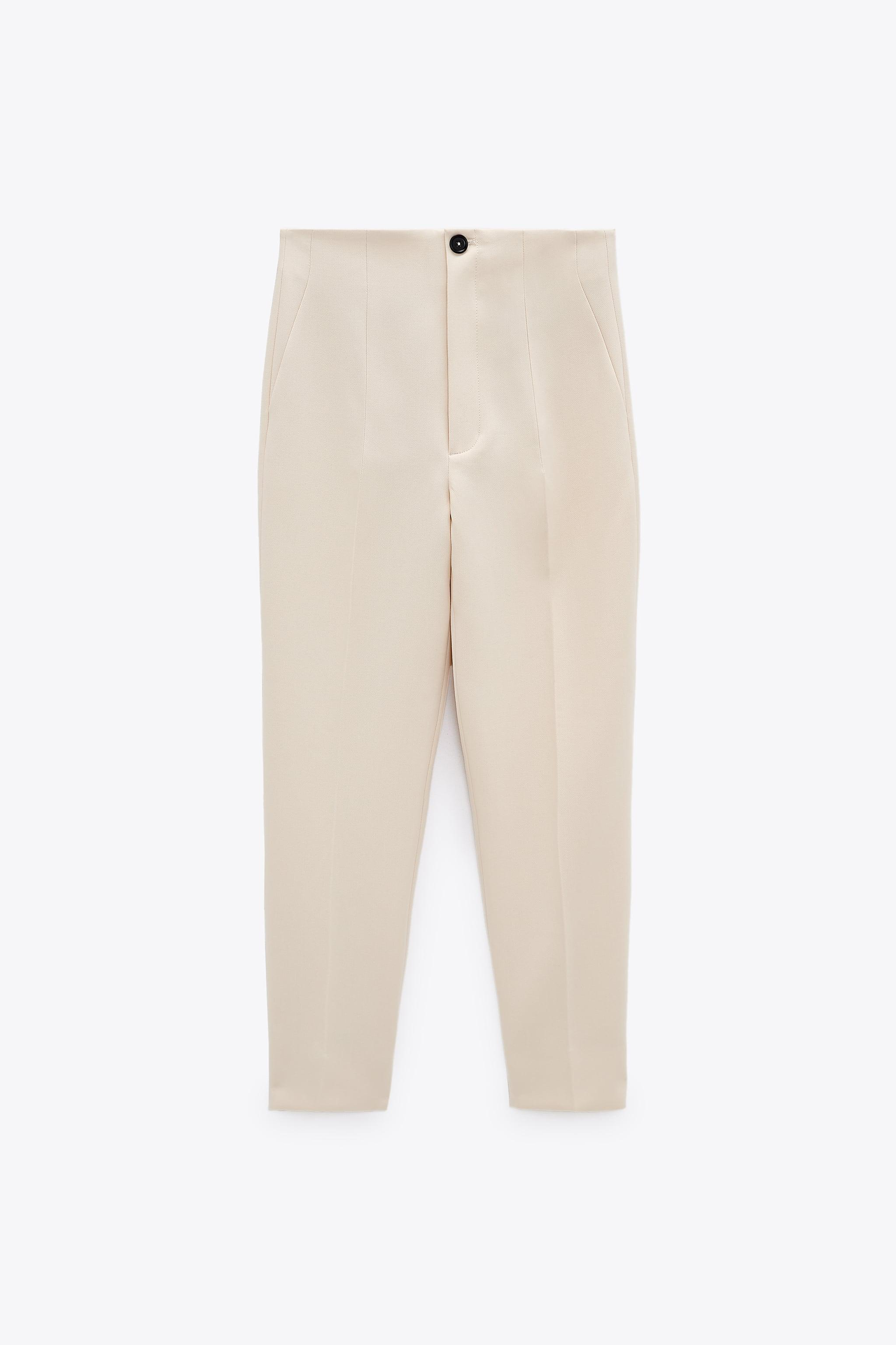 HIGH-WAISTED PANTS WITH VENTS 8