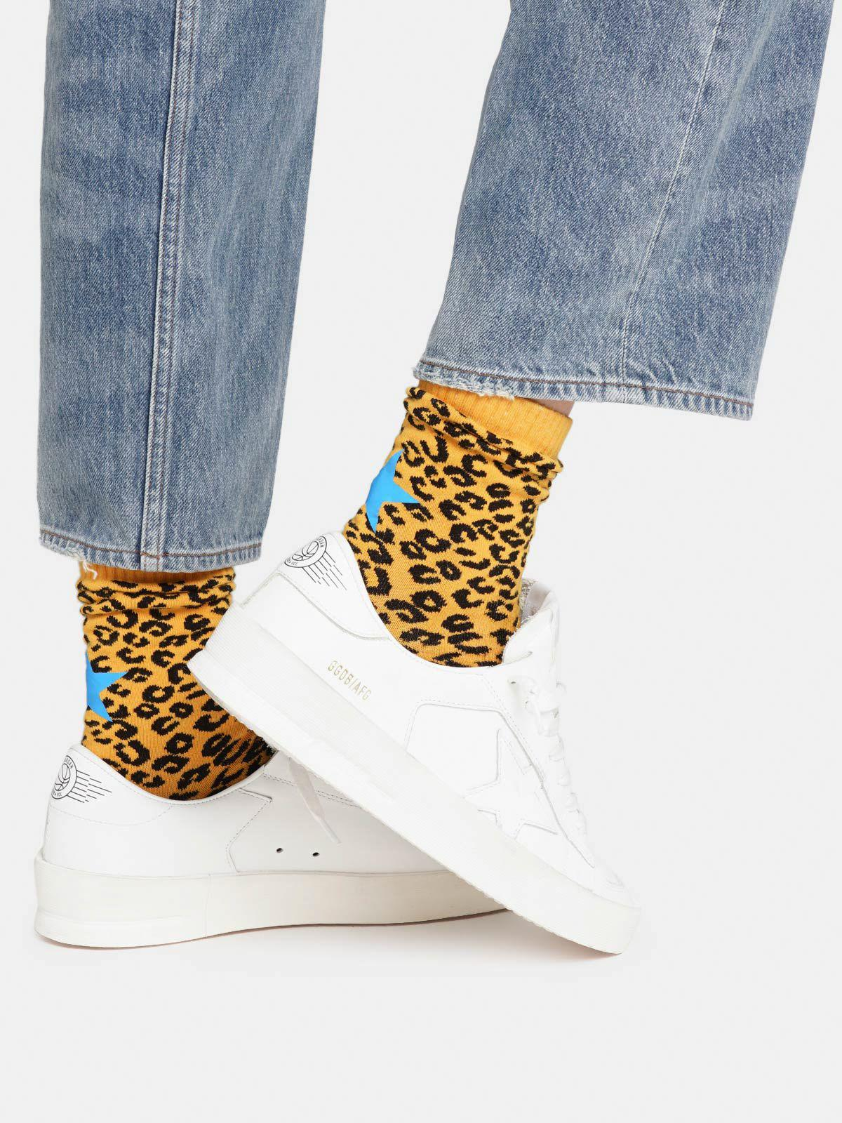 Animal-print socks with ochre-yellow base with turquoise details
