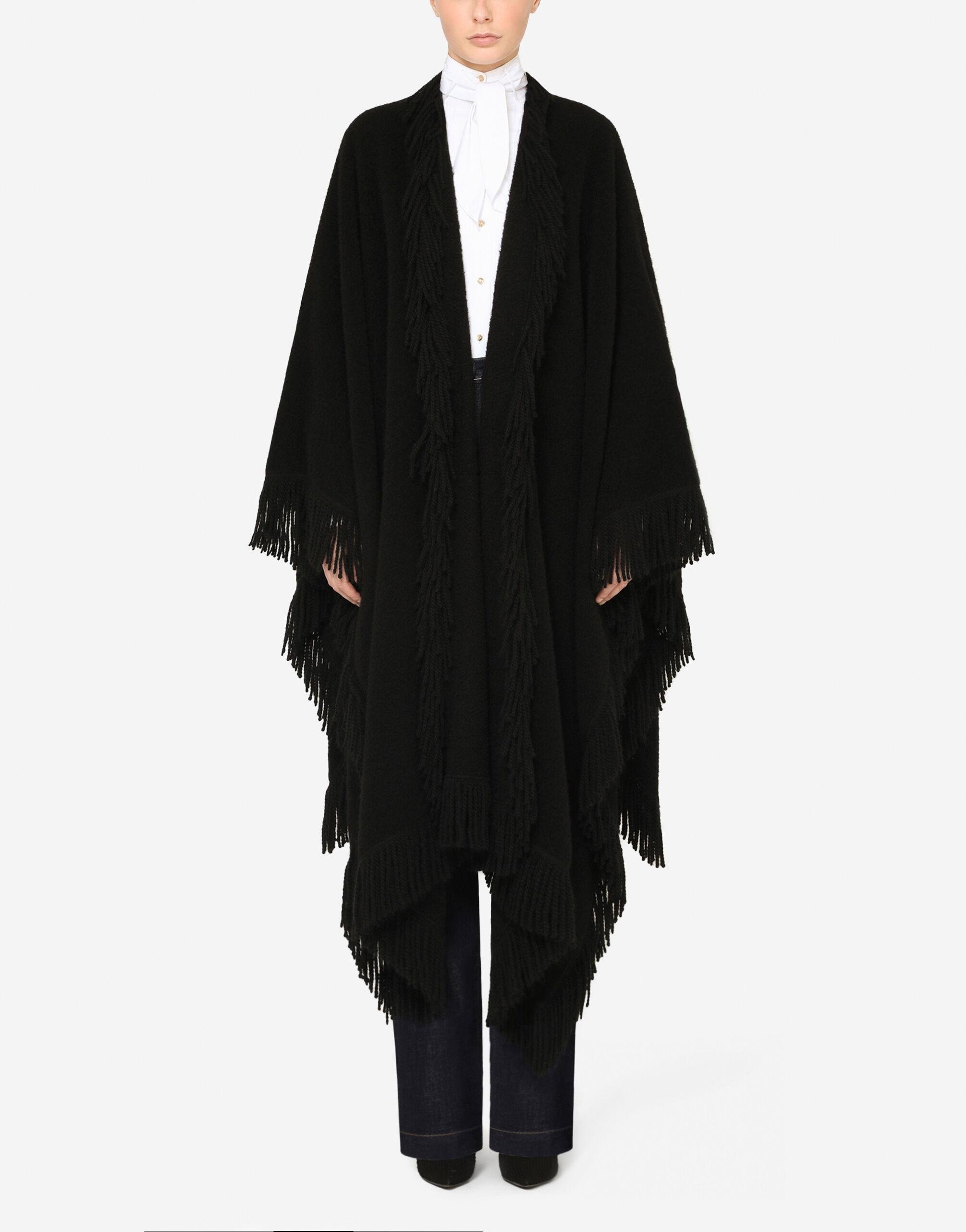 Cape with fringing