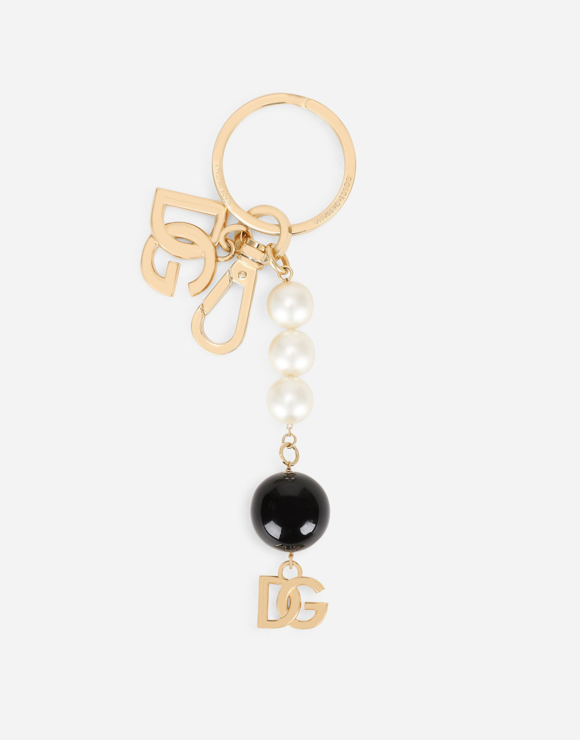 Metal keychain with DG logo and pearls