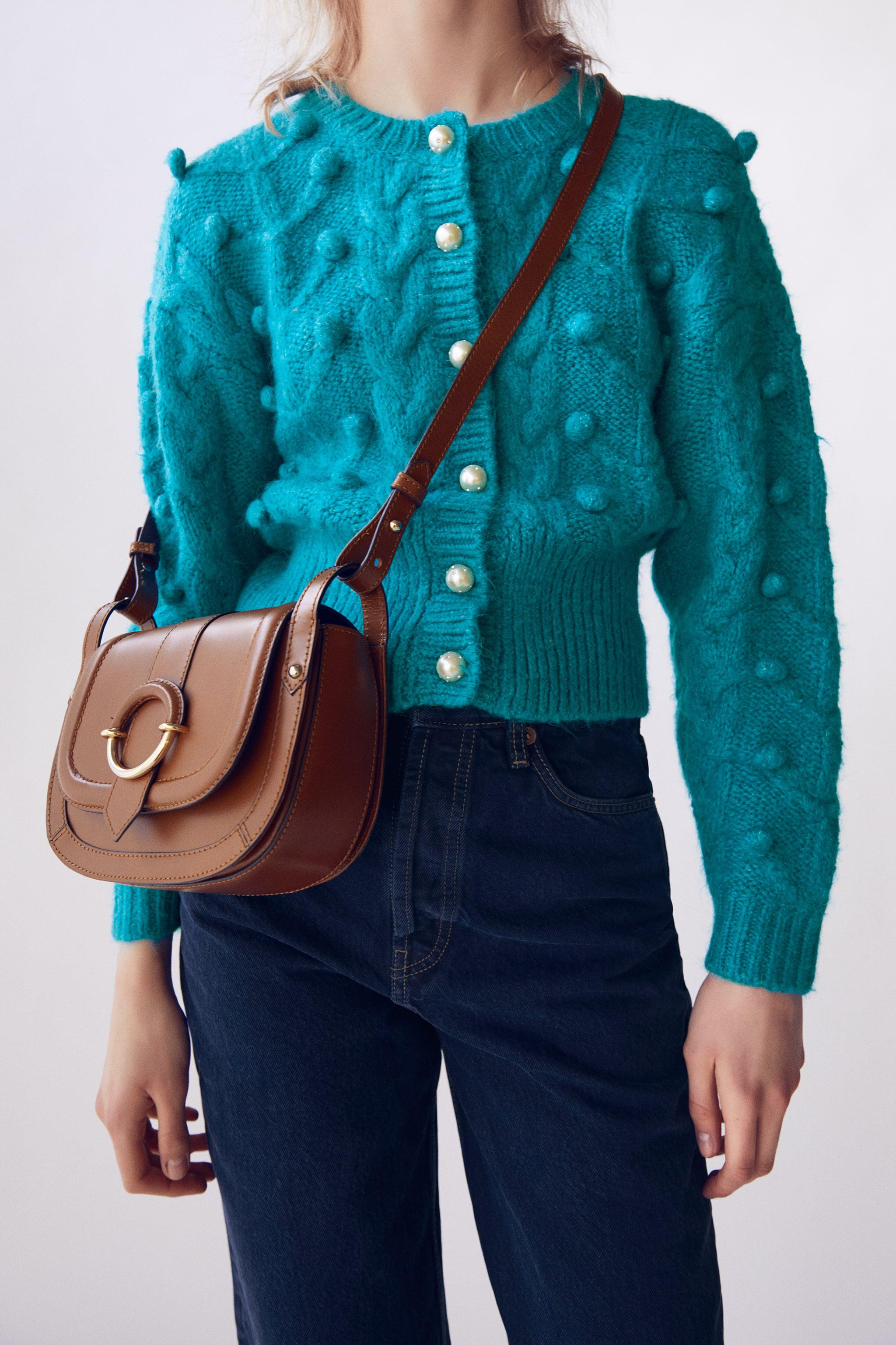 OVAL LEATHER CROSSBODY BAG WITH BUCKLE