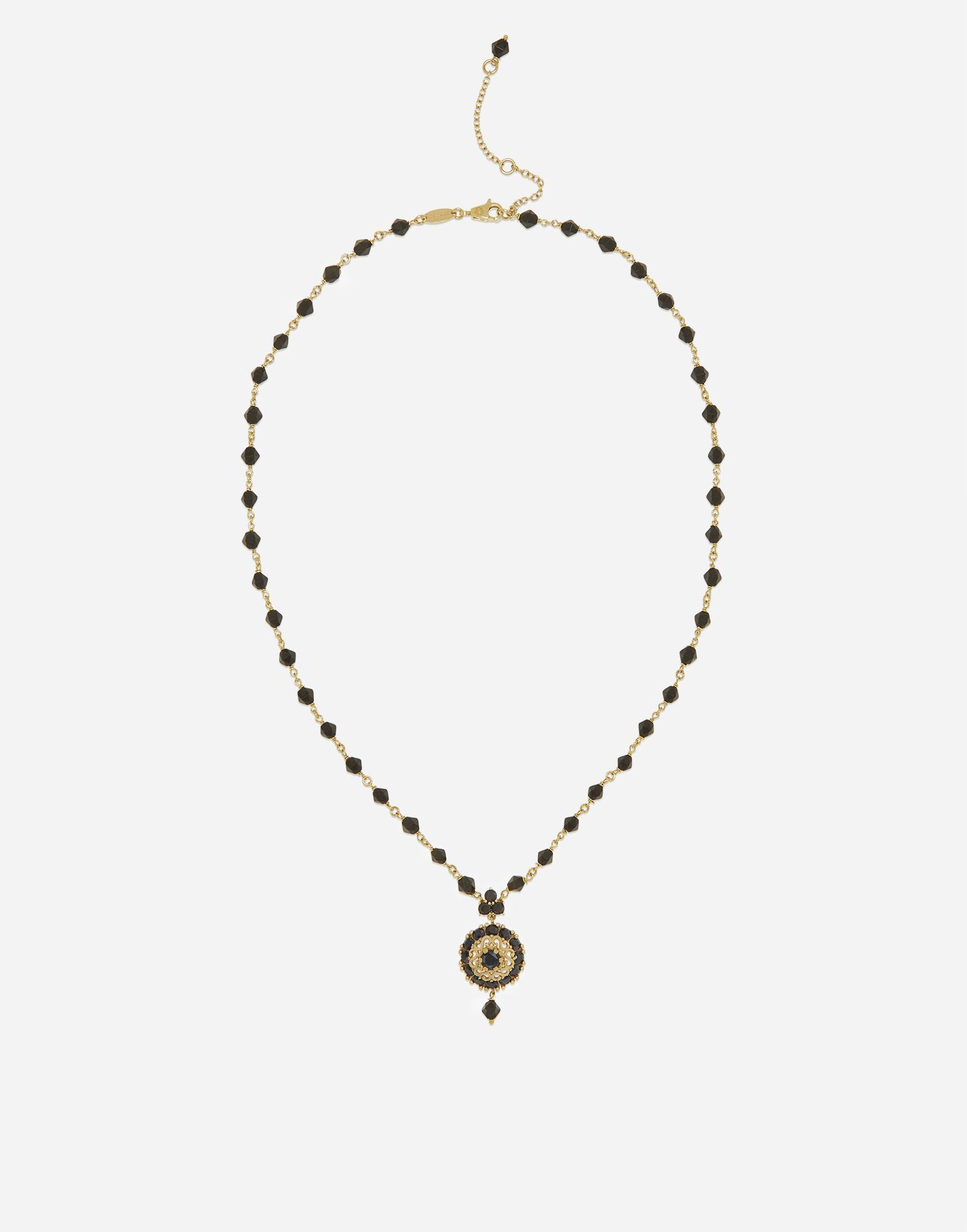 Necklace with black jade and sapphire pendant