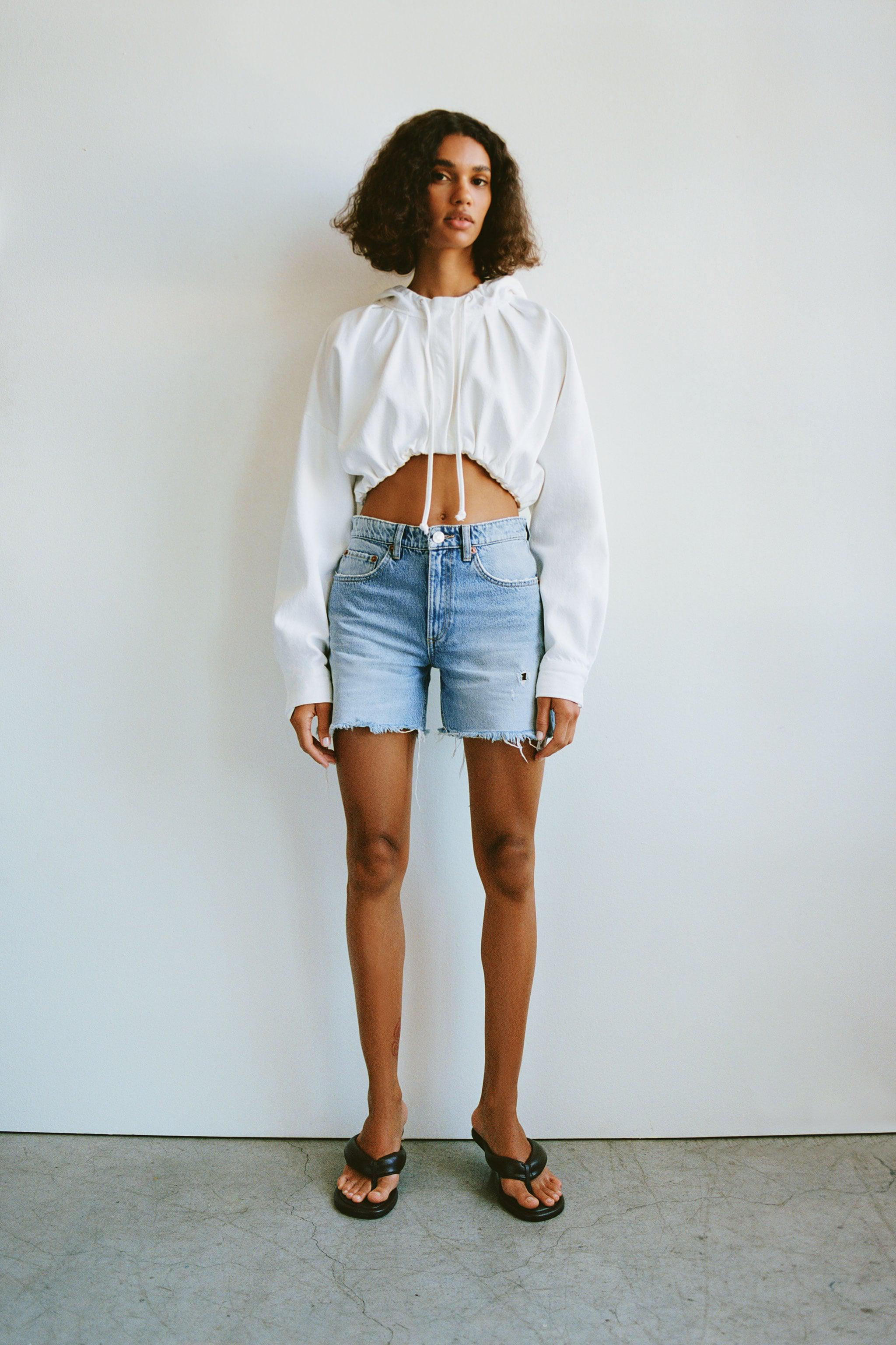 RELAXED RIPPED MID RISE SHORTS