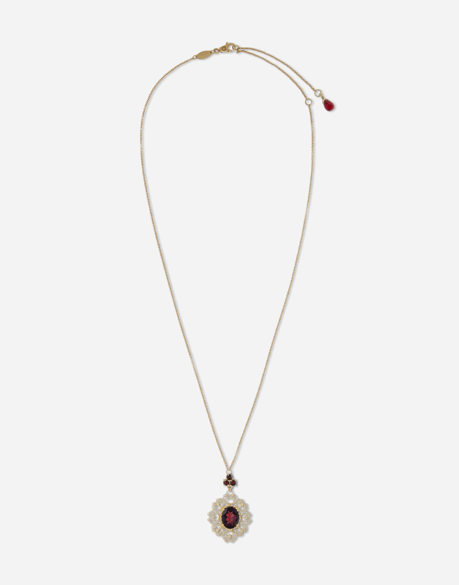 Barocco pendant in yellow gold with rhodolite garanets