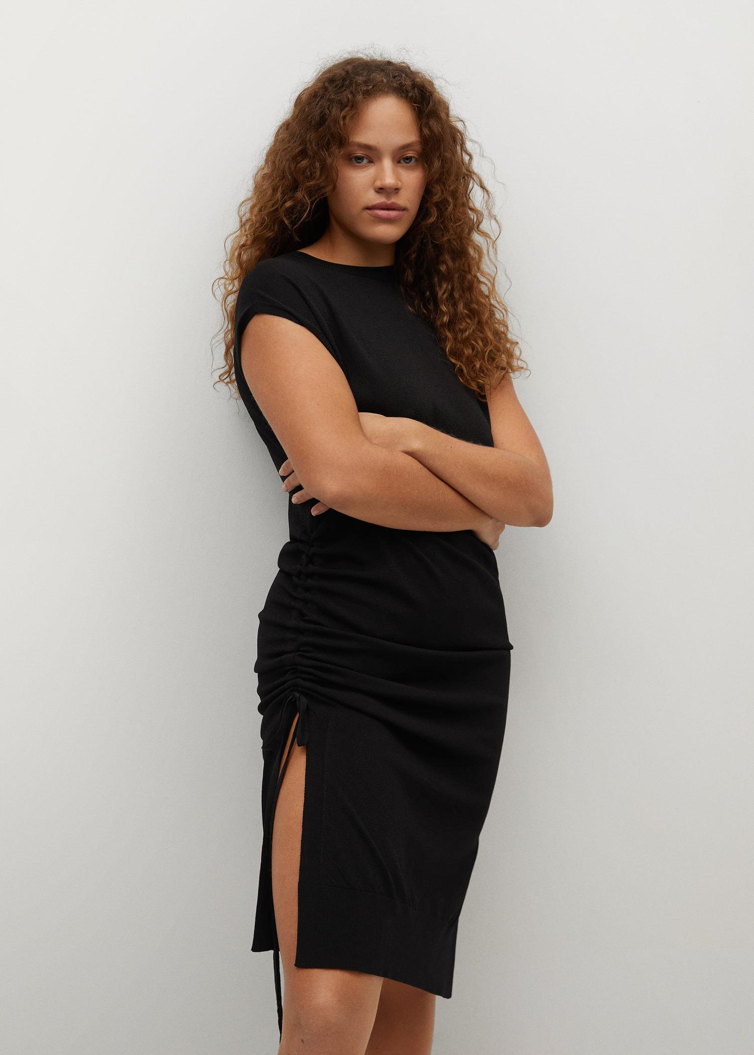 Knitted dress with openings