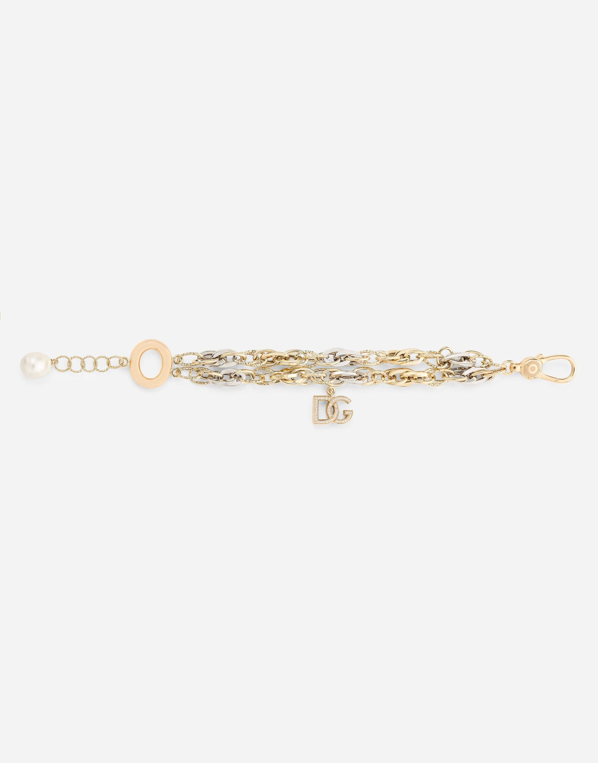 Logo bracelet in yellow and white 18kt gold with colorless sapphires 1
