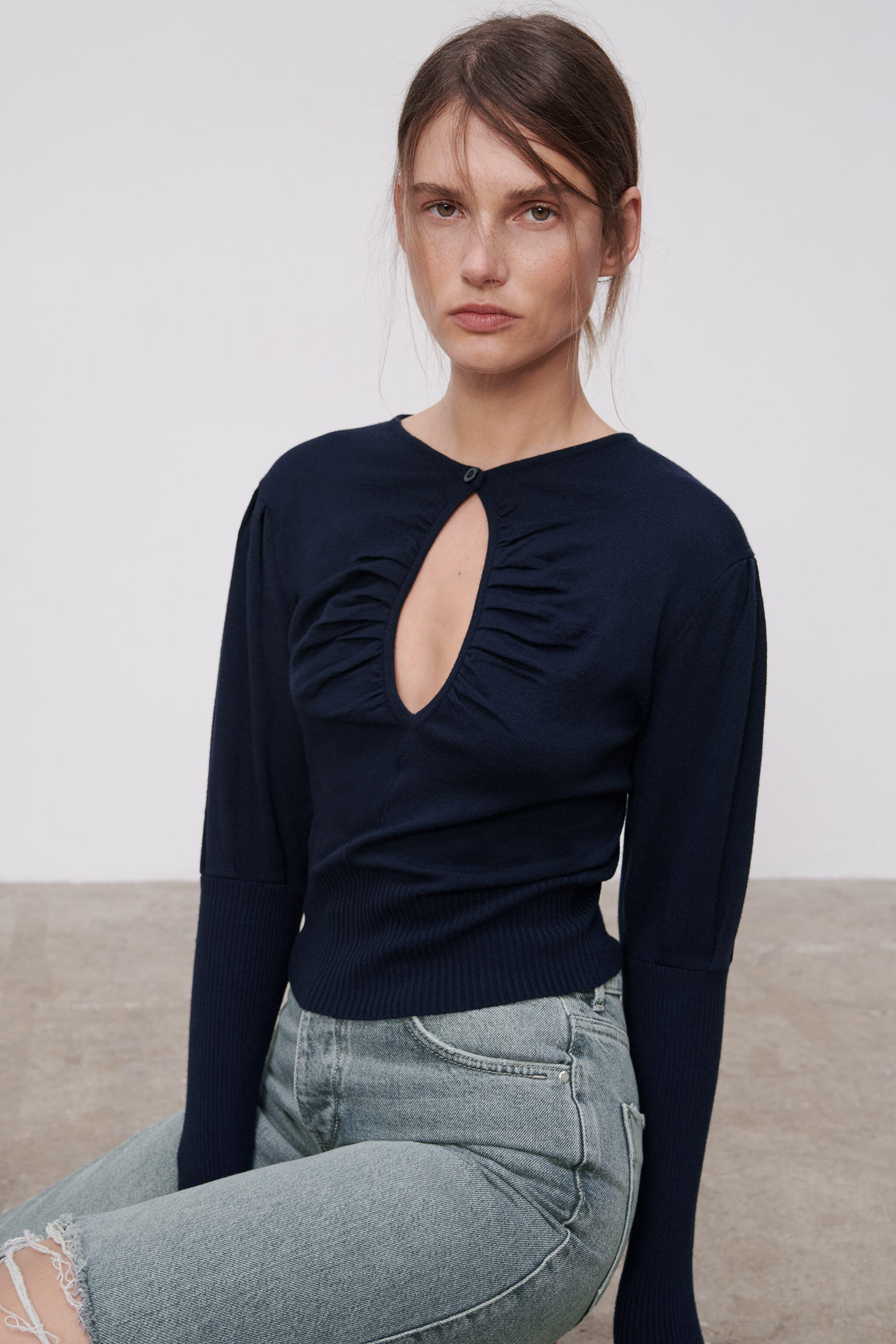 CUT OUT KNIT SWEATER 2