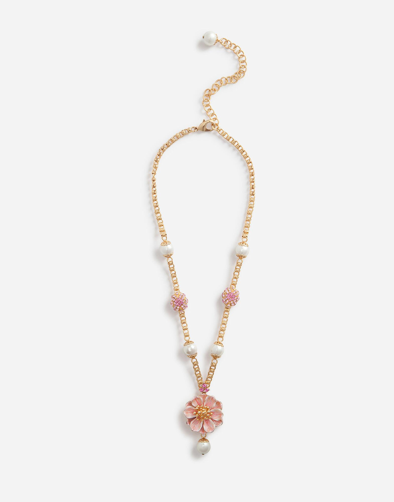 Necklace with resin pearls and flower pendant