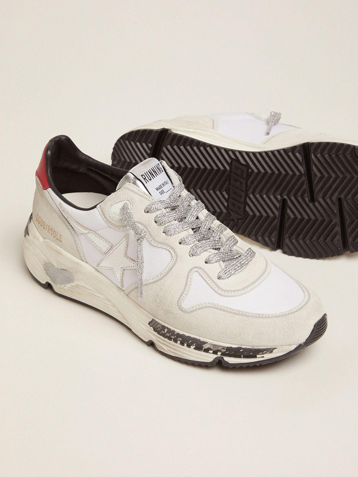 Running Sole sneakers with red heel tab and silver star 2