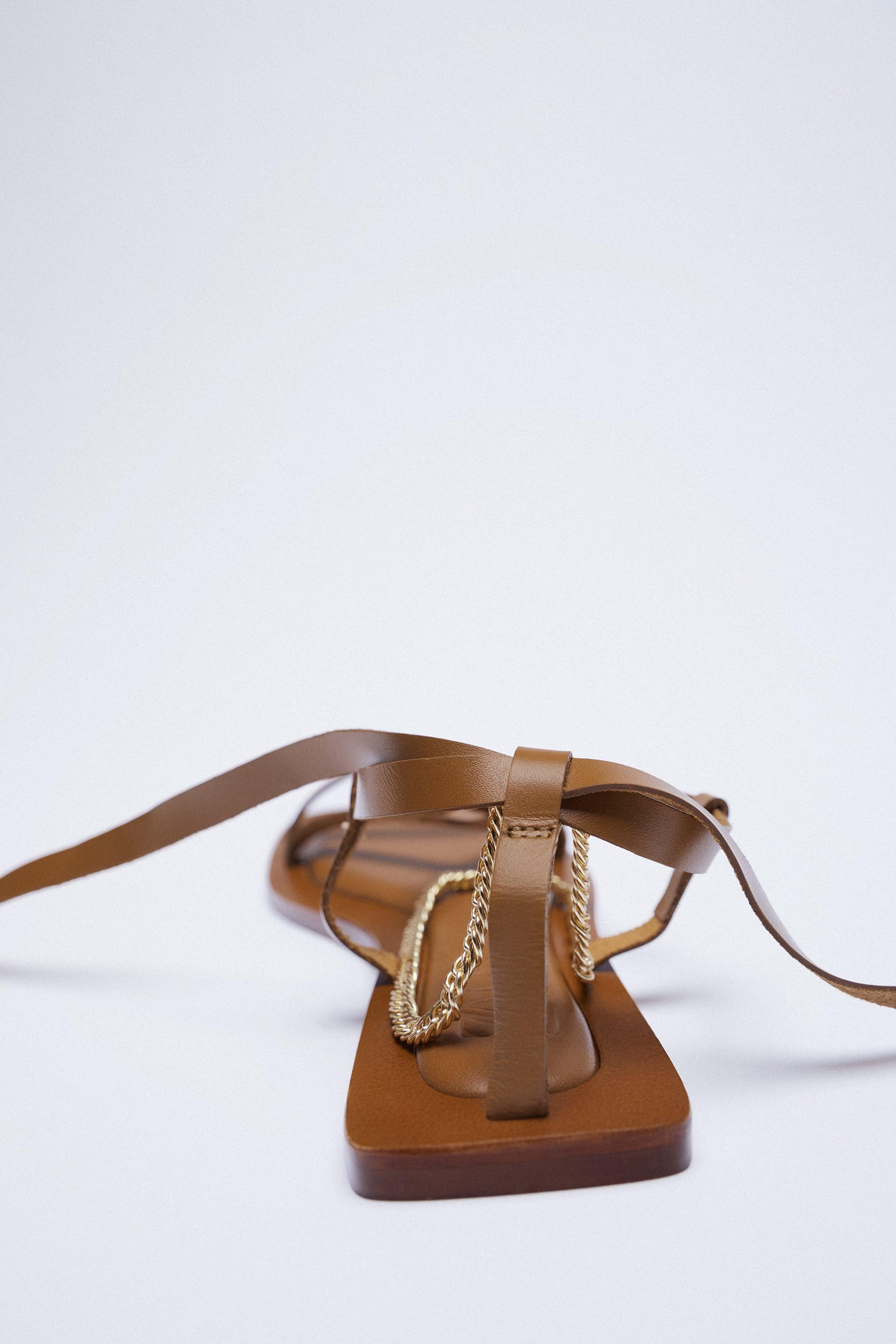 FLAT LEATHER SANDALS WITH TIED HEEL AND CHAIN 4