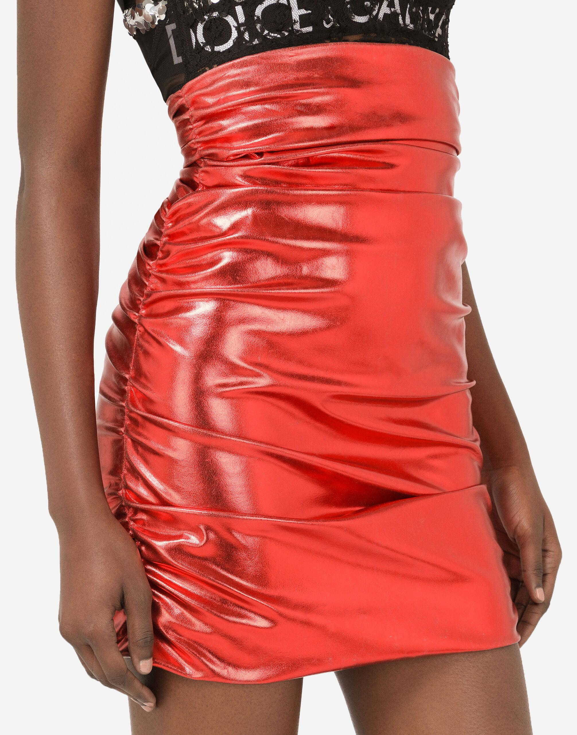 Foiled fabric miniskirt with draping 2
