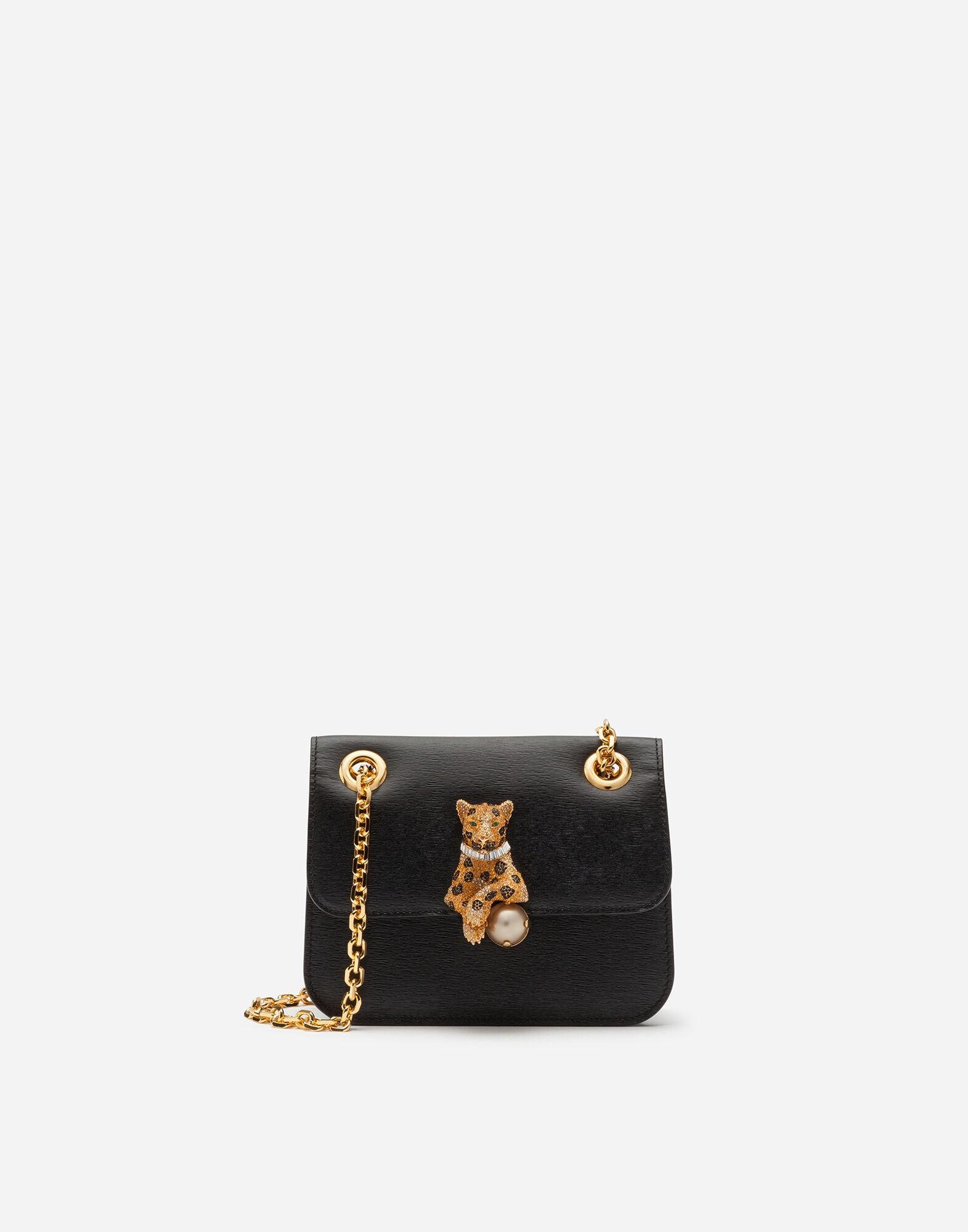 Small jungle bag in calfskin with bejeweled closure