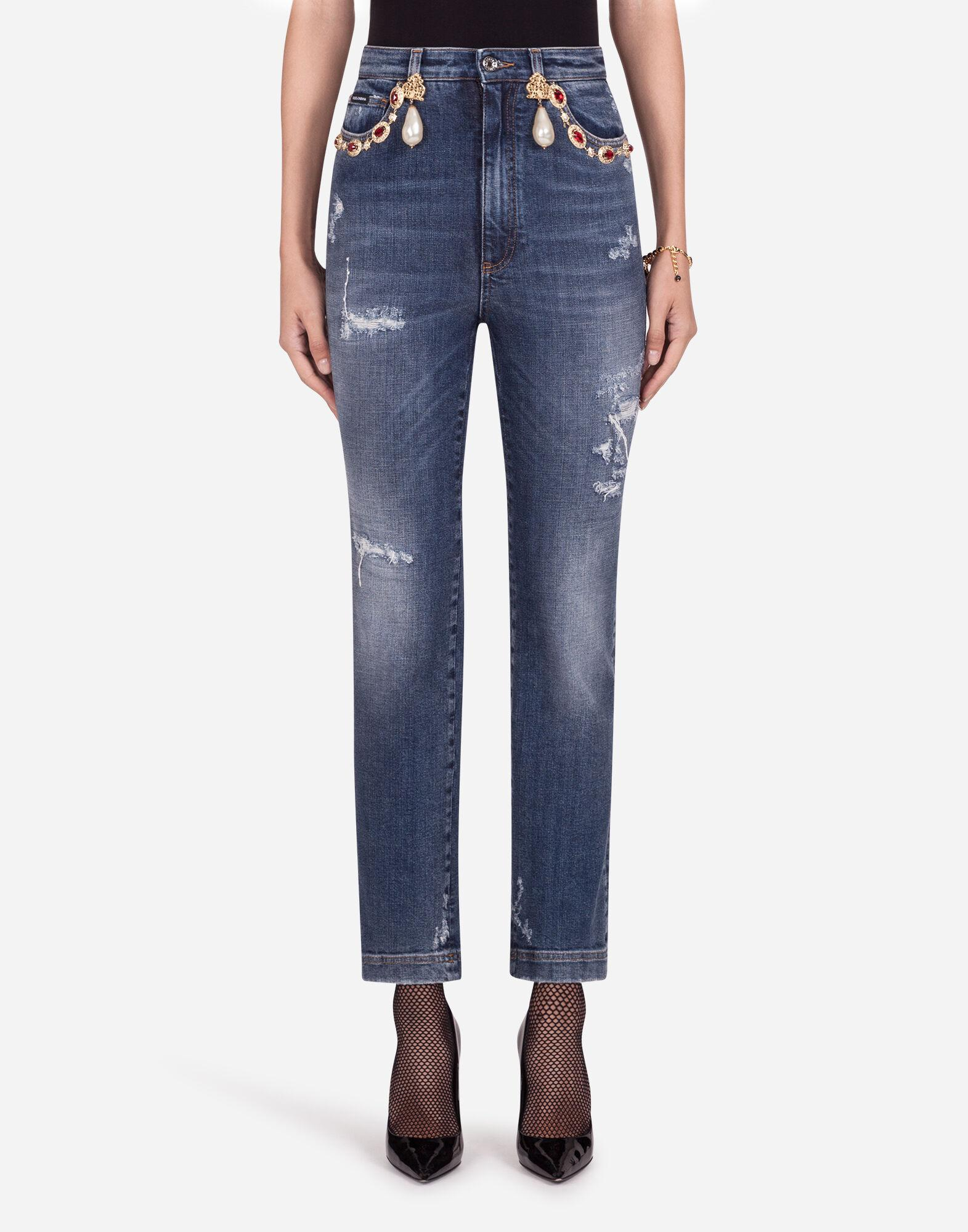 High-waisted jeans with pearls and embellishments