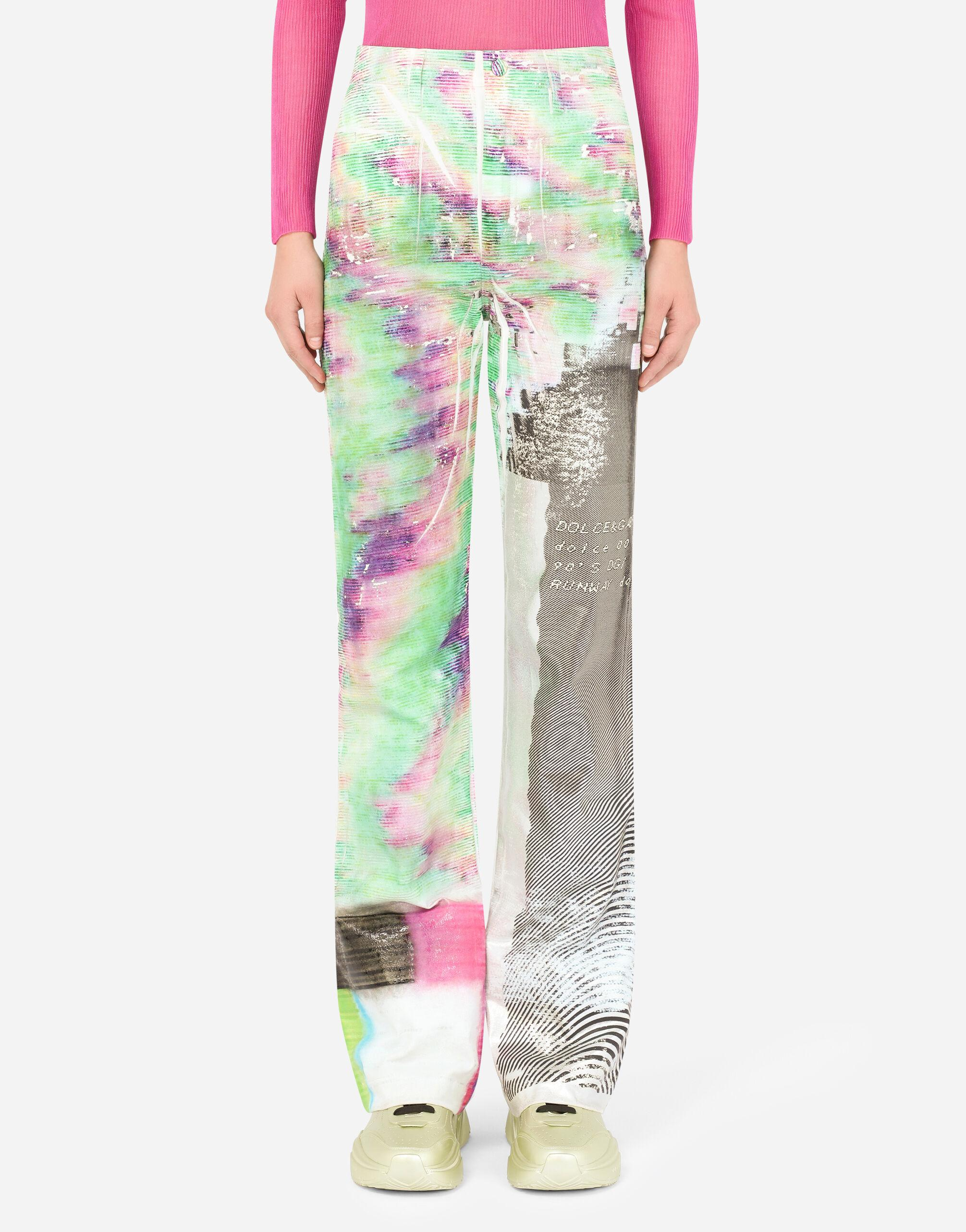 Flared jeans with foiled multi-colored glitch print