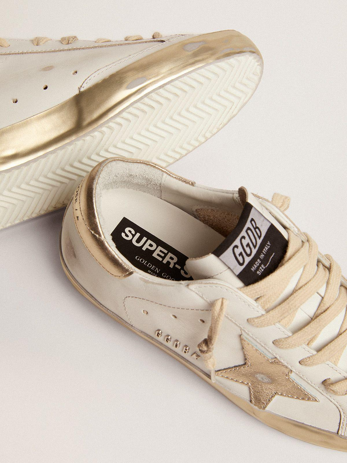 Super-Star sneakers with gold sparkle foxing and metal stud lettering 2