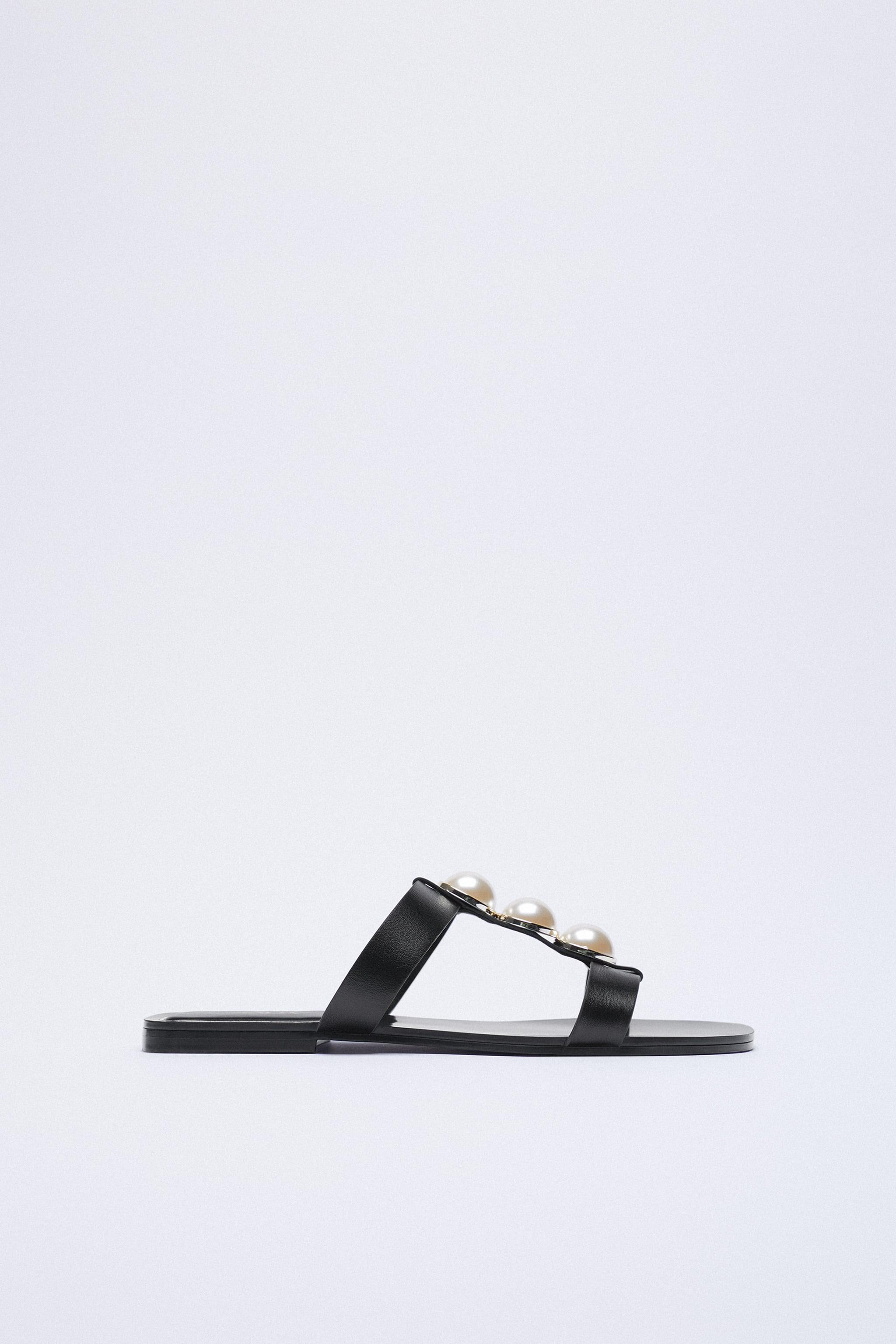 LOW HEEL LEATHER SANDALS WITH PEARL STRAPS