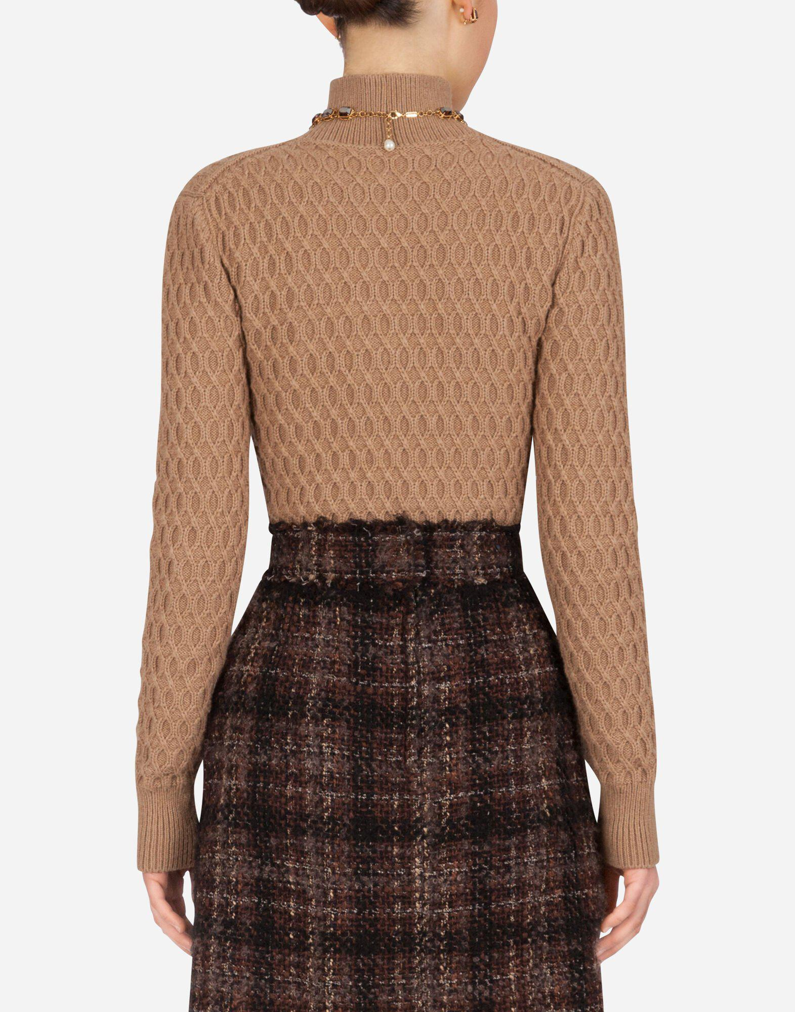 High-neck sweater in camel with rhombus stitch 1