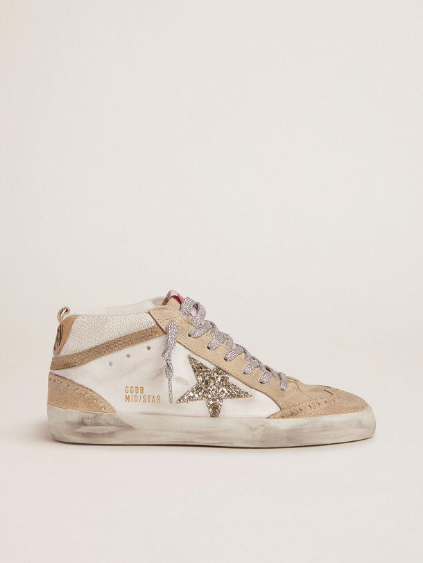 Mid Star LTD sneakers with light green glitter star and snake-print leather insert