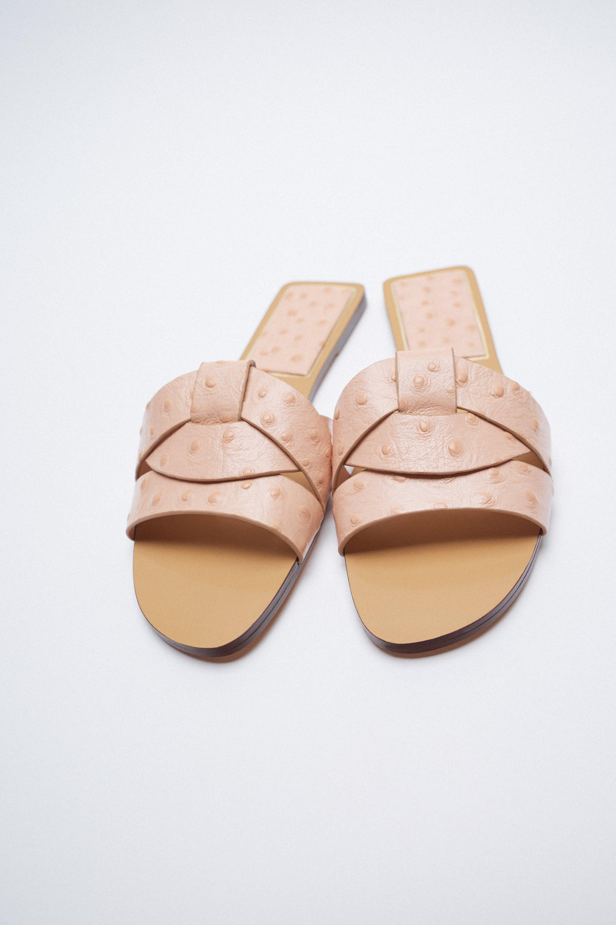 LOW HEELED CROSSED LEATHER SANDALS 1