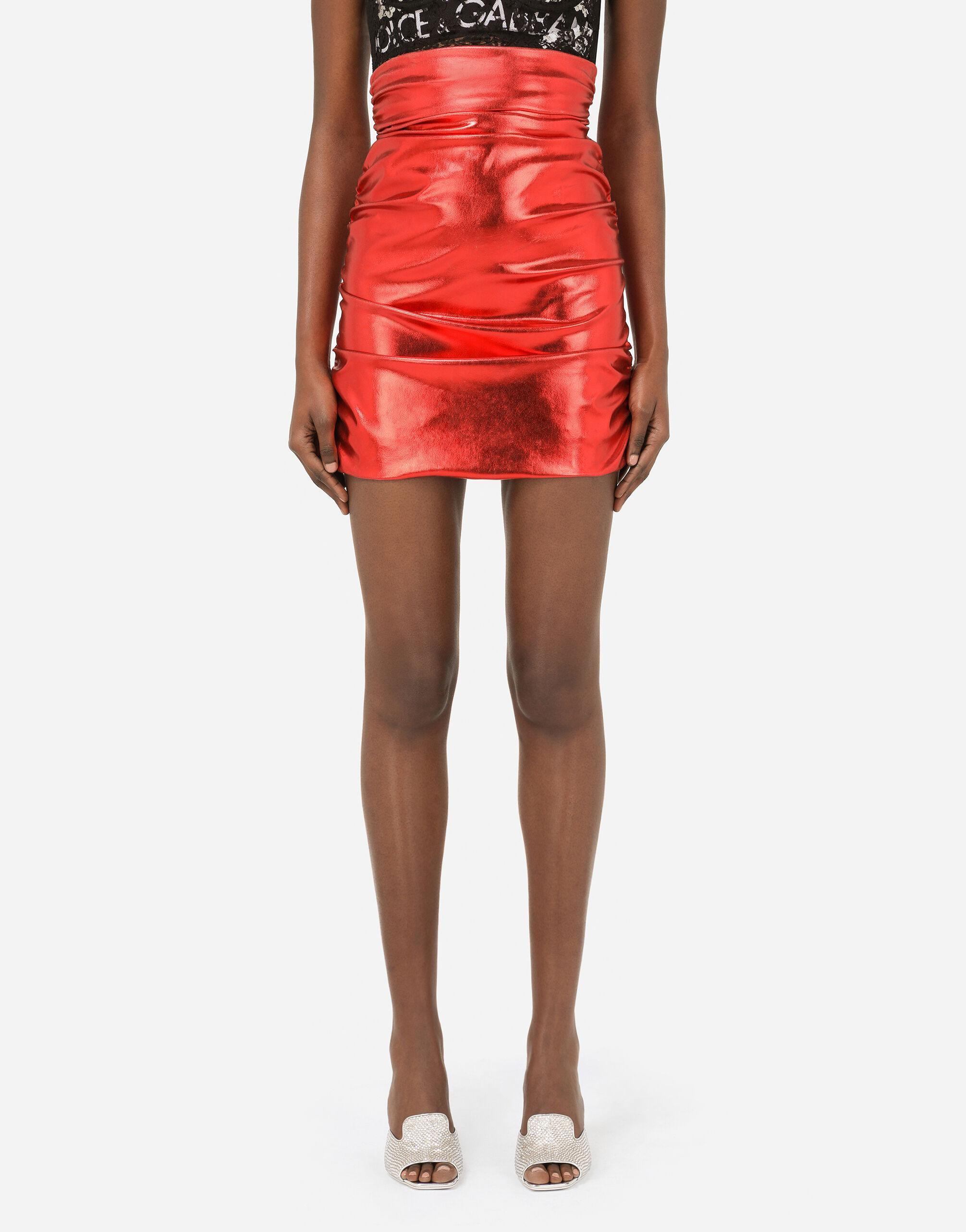 Foiled fabric miniskirt with draping
