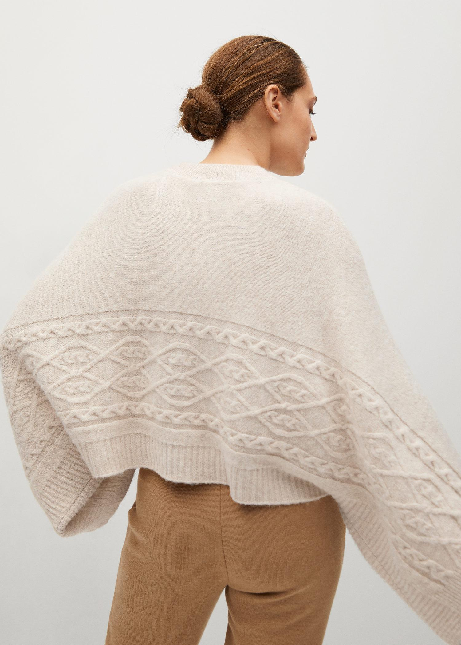 Oversized knitted cape 6