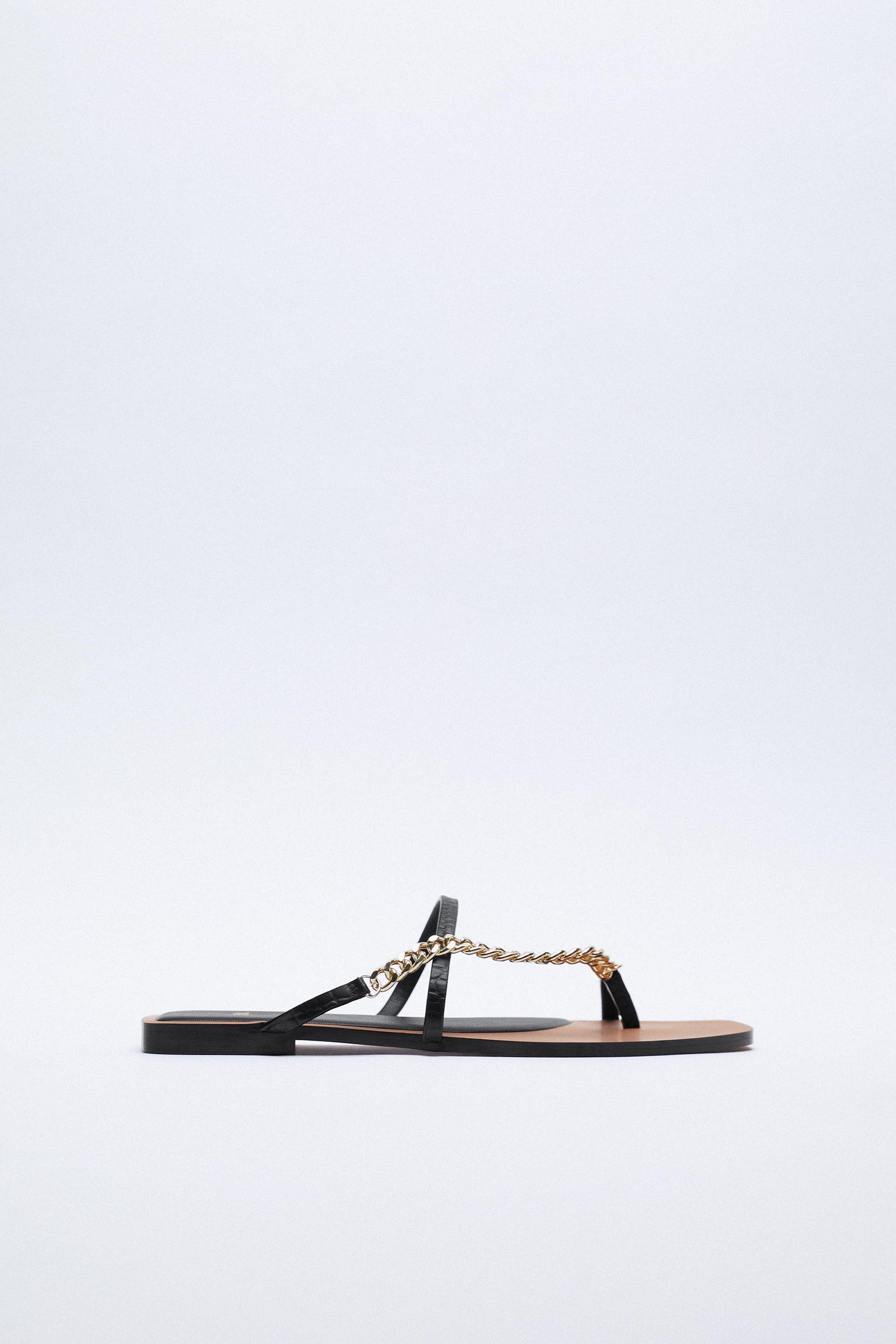 FLAT LEATHER SANDALS WITH CHAIN