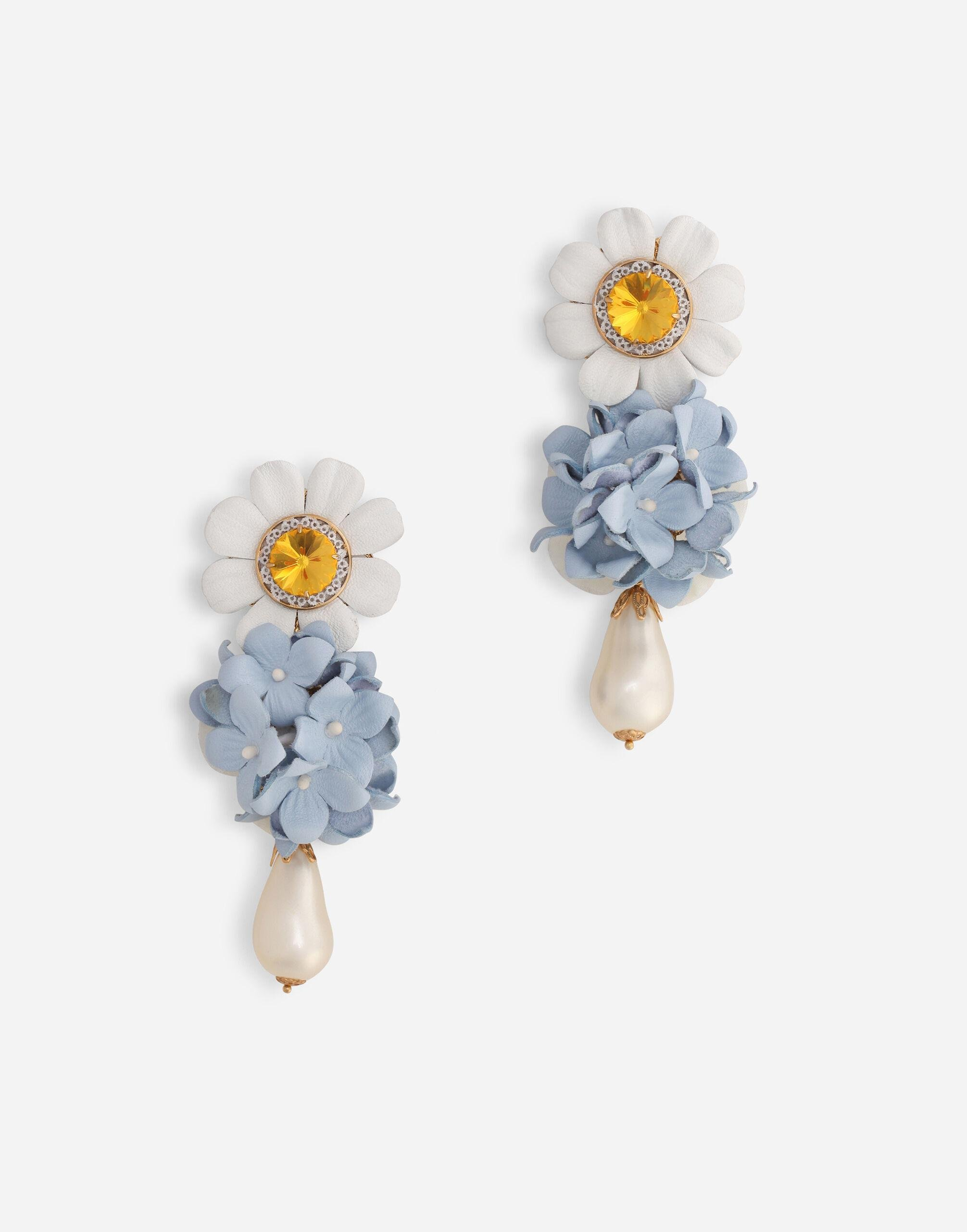 Drop earrings with leather embellishment