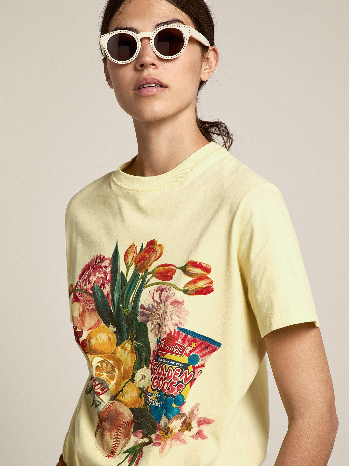 Pastel yellow Journey Collection T-shirt with colorful collage-style print