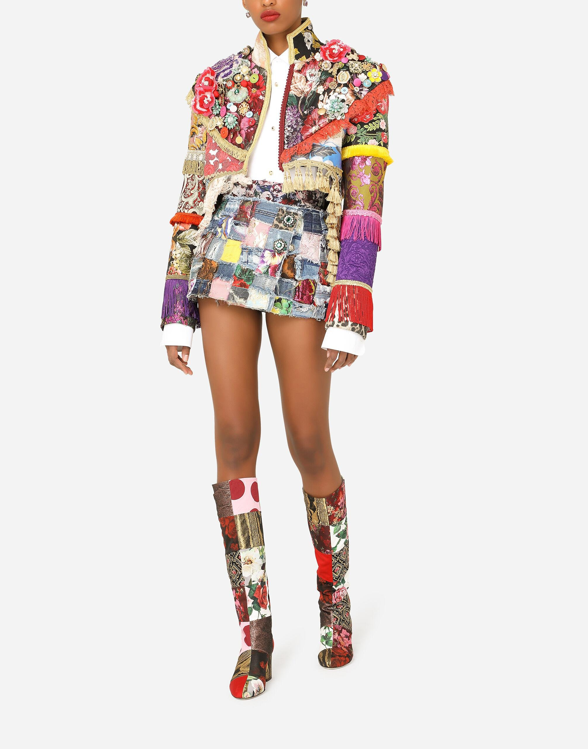 Denim miniskirt with interwoven patchwork detailing and bejeweled buttons 3