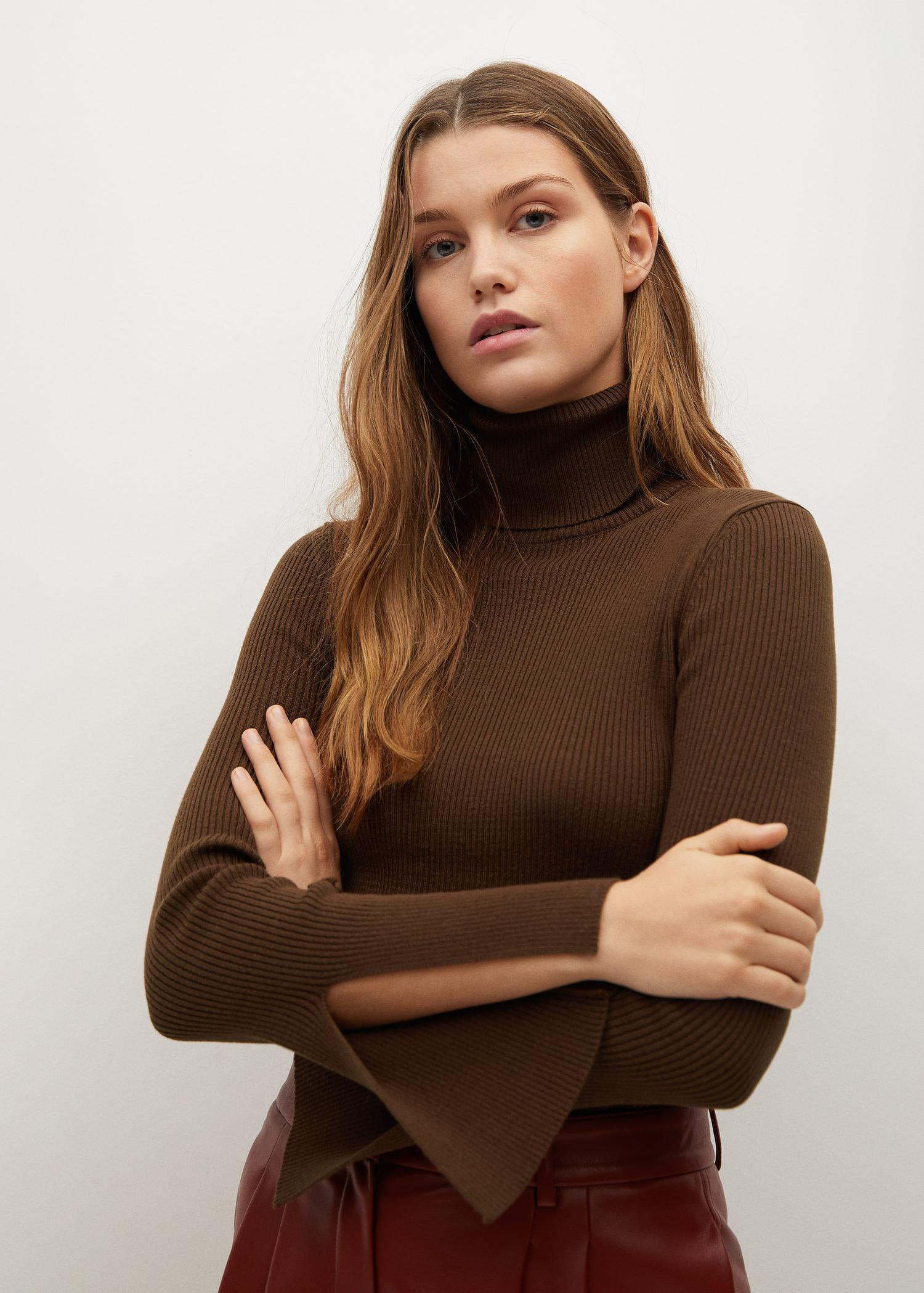 Rolled neck cable sweater