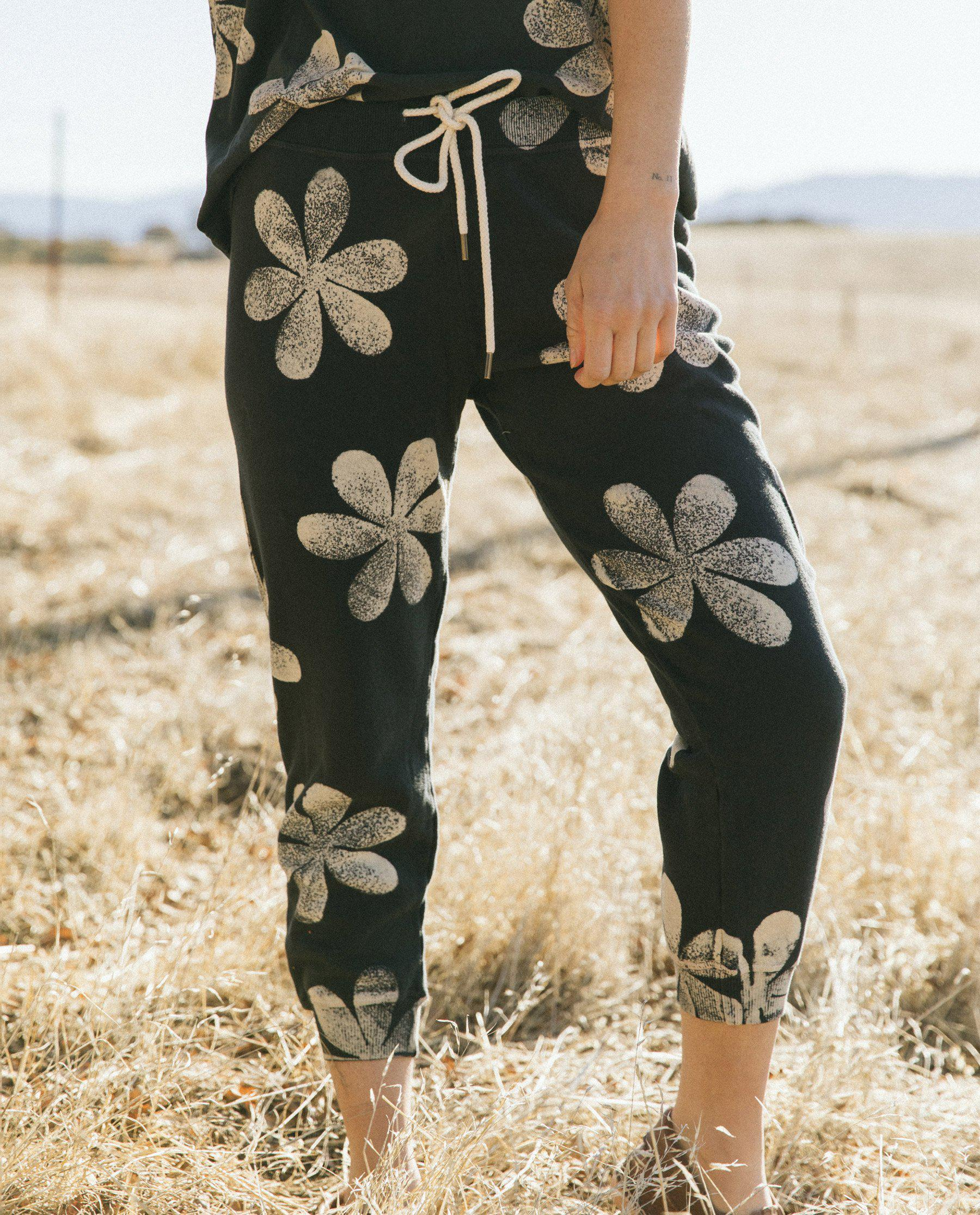 The Cropped Sweatpant. Novelty -- Almost Black with Daisy Stamp