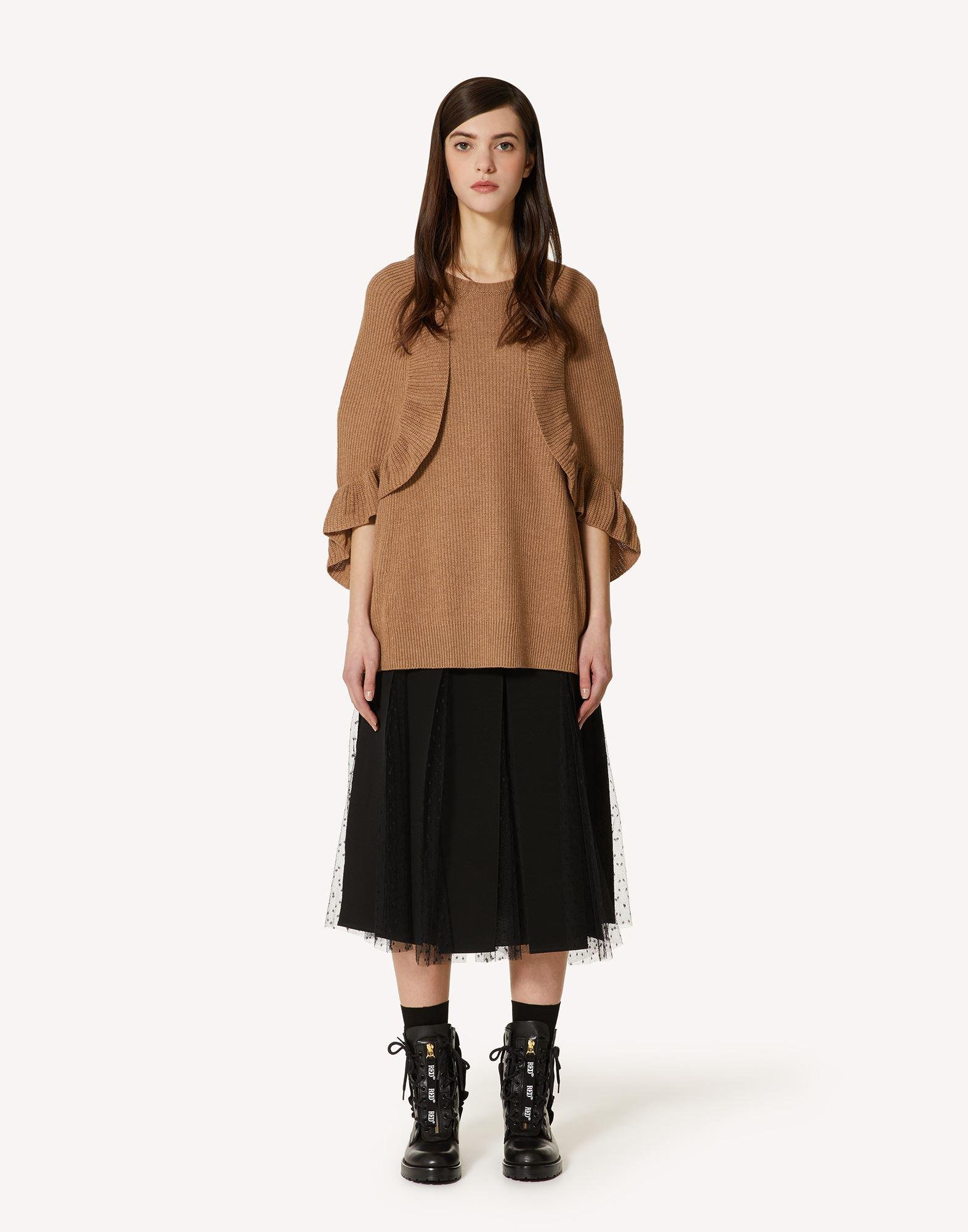 WOOL KNIT CAPE WITH RUFFLE DETAIL