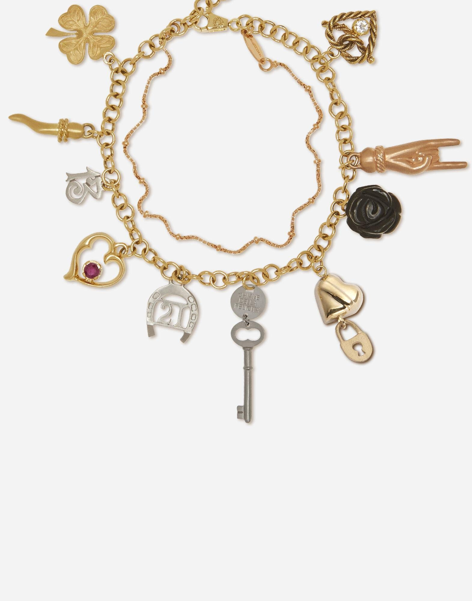 Family bracelet in yellow, white and red gold with black jades and ruby 1